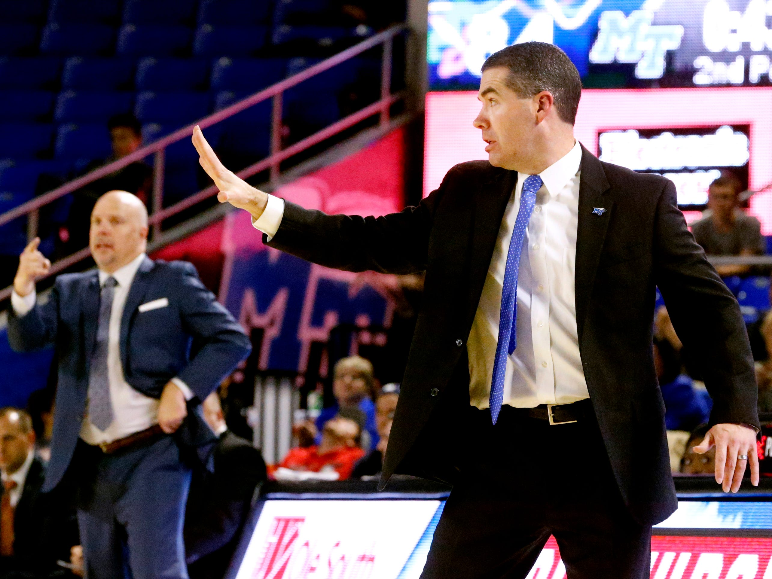 MTSU's head coach Nick McDevitt on the sidelines with UTSA's head coach Steve Henson in the background during the second half of the game on Thursday Jan. 17, 2019.