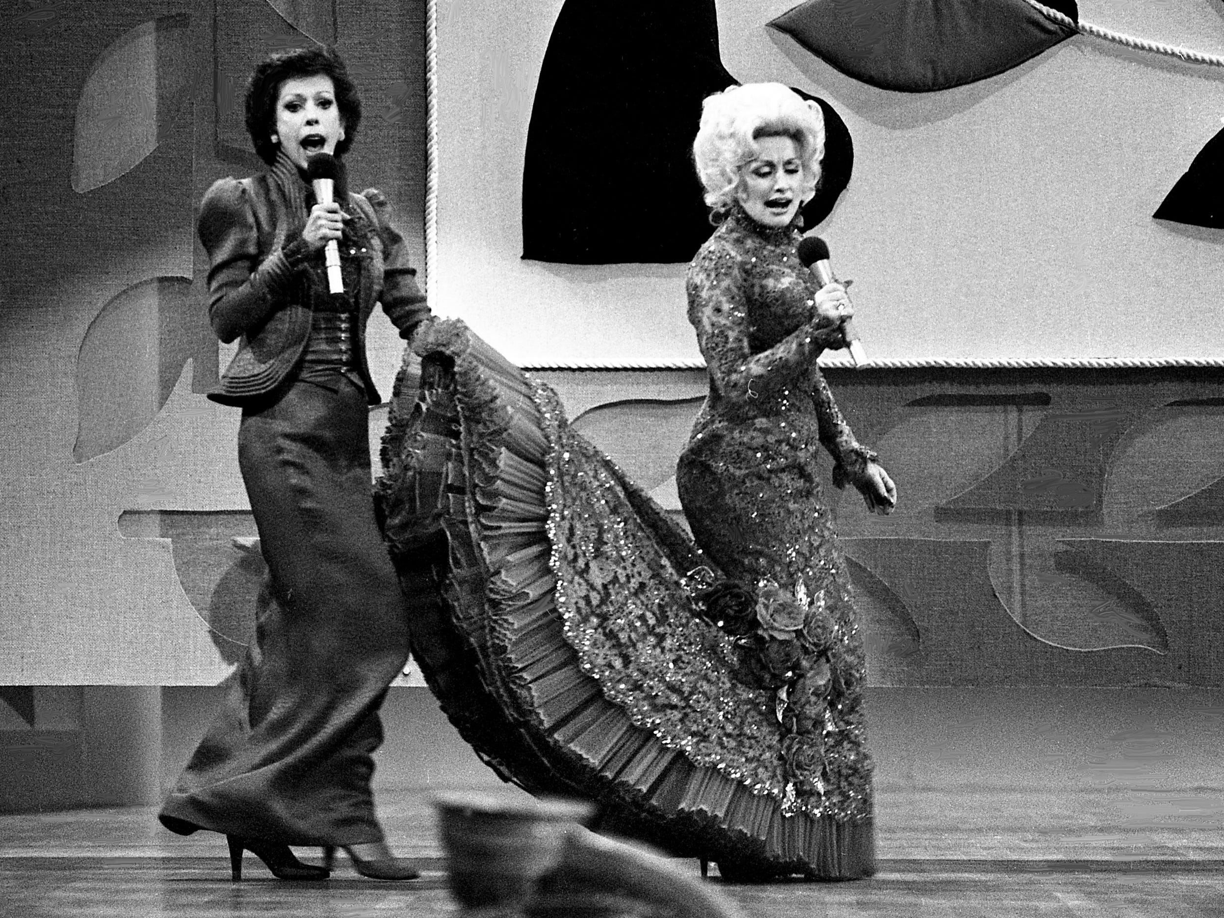 "Carol Burnett and Dolly Parton are performing during their mock-melodramatic love song skit during the taping of the ""Dolly and Carol in Nashville"" television special before a packed audience at the Grand Ole Opry House on Jan. 10, 1979."