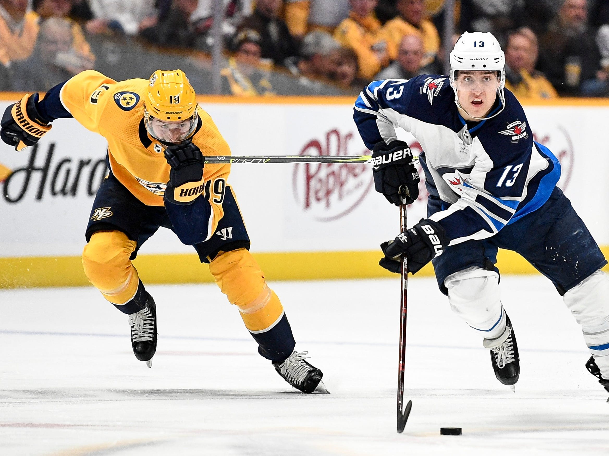 Winnipeg Jets left wing Brandon Tanev (13) skates past Nashville Predators center Calle Jarnkrok (19) during the second period at Bridgestone Arena in Nashville, Tenn., Thursday, Jan. 17, 2019.