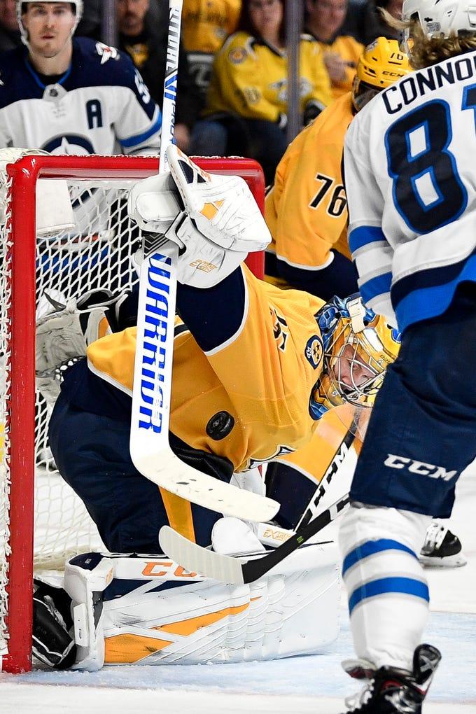 Nashville Predators goaltender Pekka Rinne (35) defends against Winnipeg Jets left wing Kyle Connor (81) during the second period at Bridgestone Arena in Nashville, Tenn., Thursday, Jan. 17, 2019.