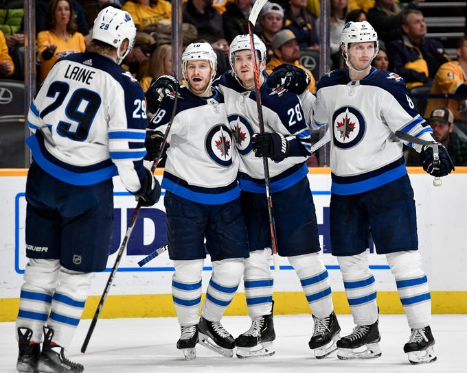 Winnipeg Jets center Bryan Little (18) reacts to scoring against the Nashville Predators during the second period at Bridgestone Arena in Nashville, Tenn., Thursday, Jan. 17, 2019.