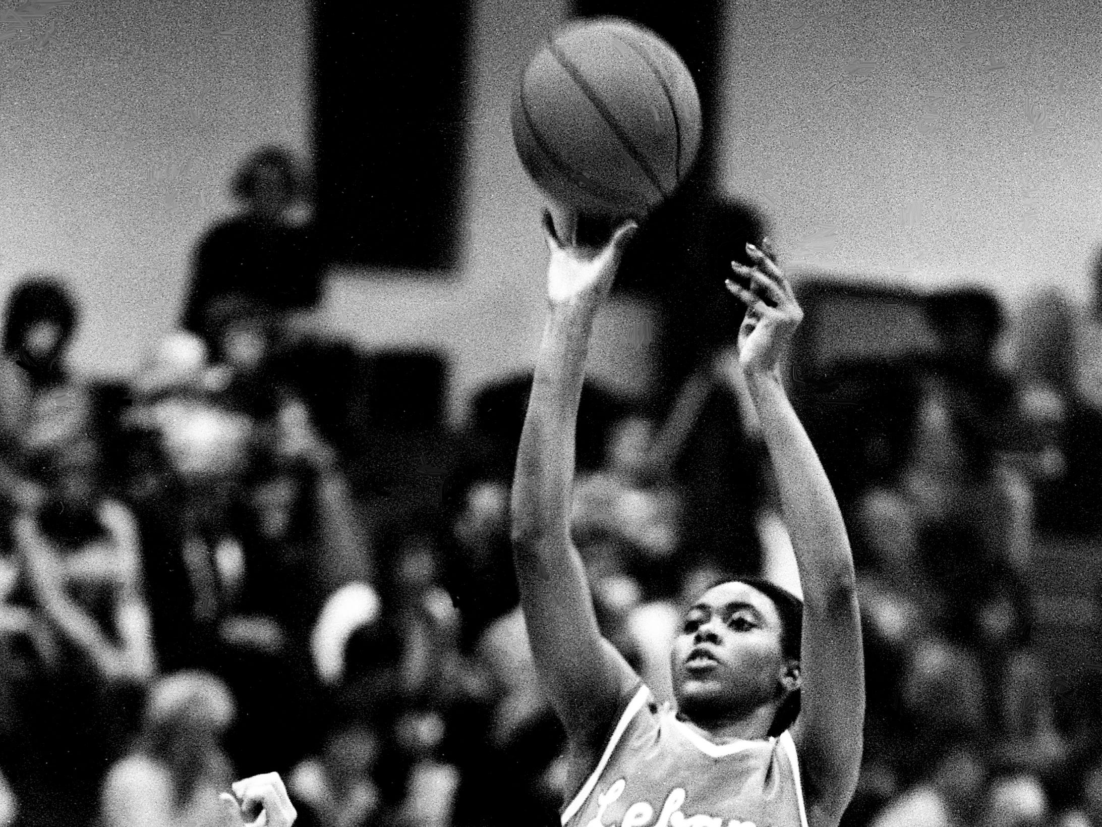 Lebanon High's Gail Corder (30) goes up for a jump shot over Mt. Juliet High defender Rhonda Foster (42) as the Lebanon's Blue Devilettes eked out a 30-28 victory on the road Jan. 16, 1979.