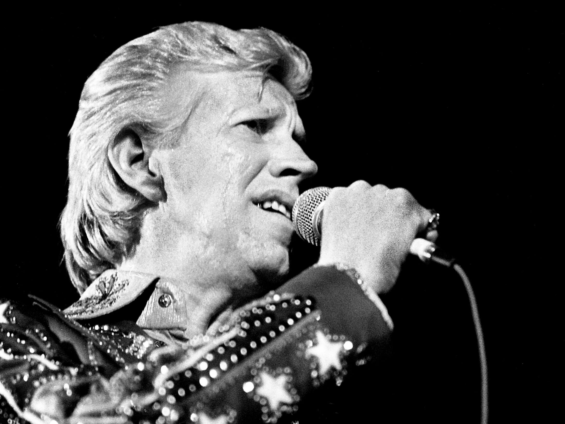 Porter Wagoner is revving up one of his traditional songs before a standing-room-only crowd at the Exit/In Jan. 31, 1979. Wagoner was unquestionably a hit, but his much-anticipated disco debut was a lot closer to the Grand Ole Opry than Studio 54.