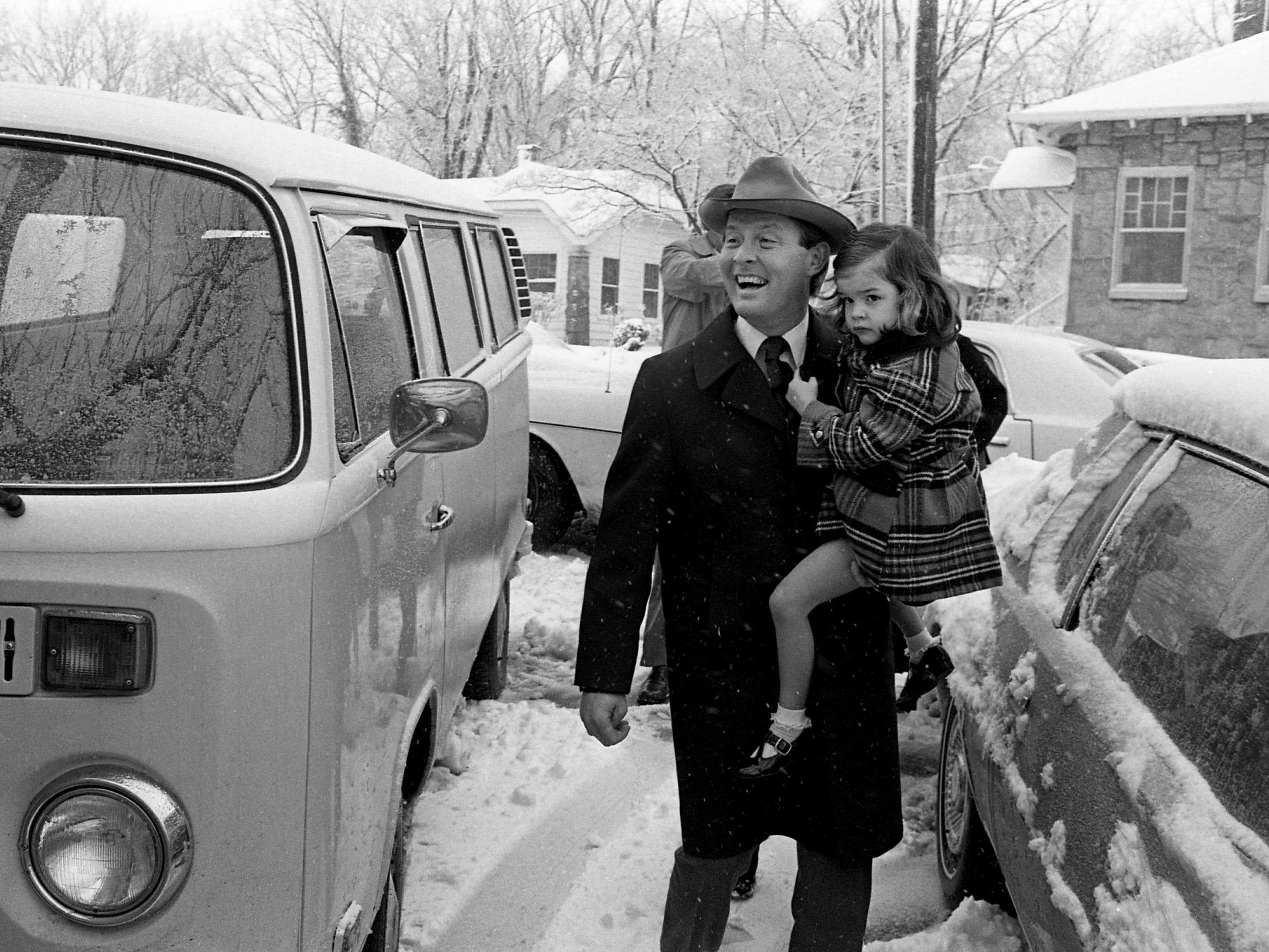 Gov. Lamar Alexander is all smiles, but daughter Kathryn is in a more pensive mood as they arrive at Westminster Presbyterian Church on Jan. 21, 1979. A special service marking Alexander's inauguration is being held at the church where he serves as a deacon. The new governor and his family arrived 10 minutes late.