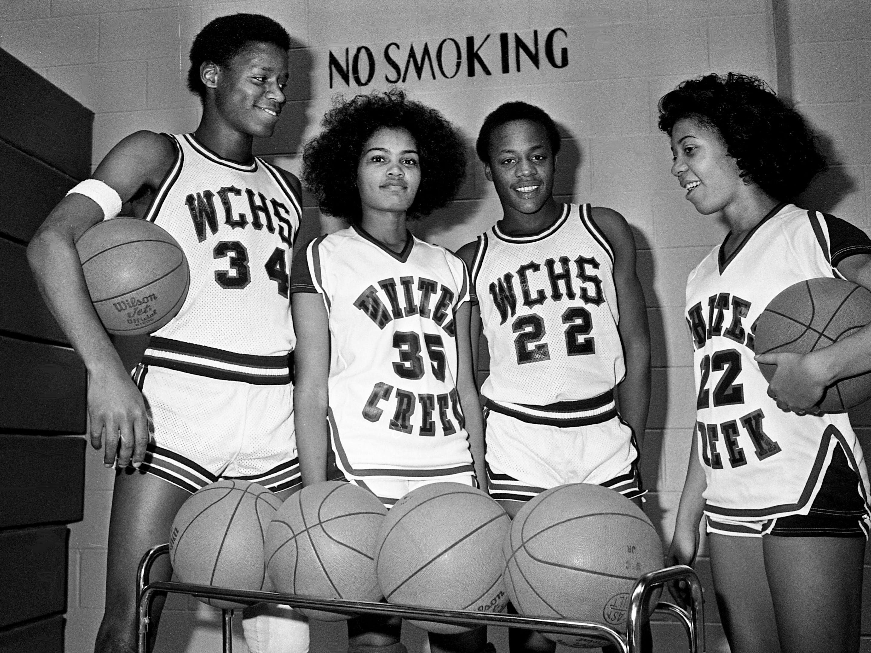 Whites Creek High's boys and girls team currently hold down second place in the District 12-AAA standings. Some of the key standouts this season gathered Jan. 25, 1979, for a photo are Greg Carey, left, Janet Moore, Robert Springer and Sandra Smith. The Cobras teams will invade Maplewood High the next night.