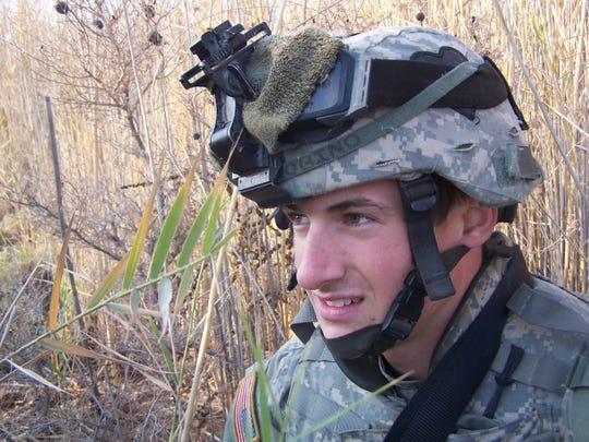 Jay Strobino on a foot patrol outside Mahmudiyah, Iraq. Strobino, a recent Middle Tennessee State University graduate, survived 13 gunshots during one-on-one combat while deployed.