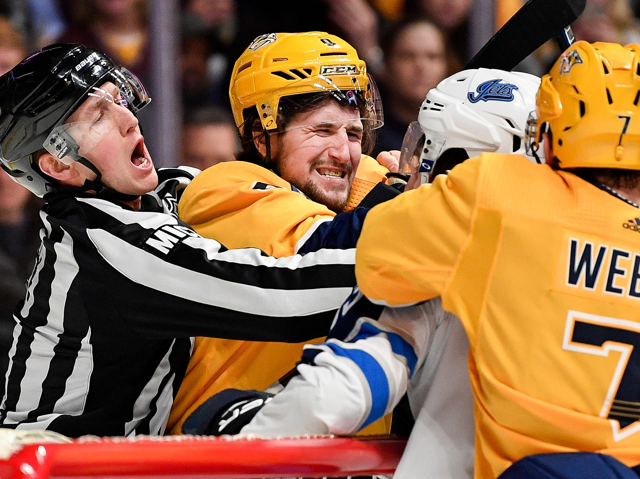 Linesman Trent Knorr (63) holds back Nashville Predators left wing Filip Forsberg (9) during a fight during the second period against the Winnipeg Jets at Bridgestone Arena in Nashville, Tenn., Thursday, Jan. 17, 2019.