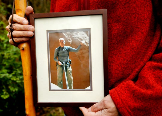 David Cicotello, of Murfreesboro, holds a photograph of his older brother Louis Cicotello. Louis Cicotello fell to his death during a day hike that the two went on. After the fall David Cicotello survived six days stranded in a slot canyon in Utah in 2011, before he was rescued.