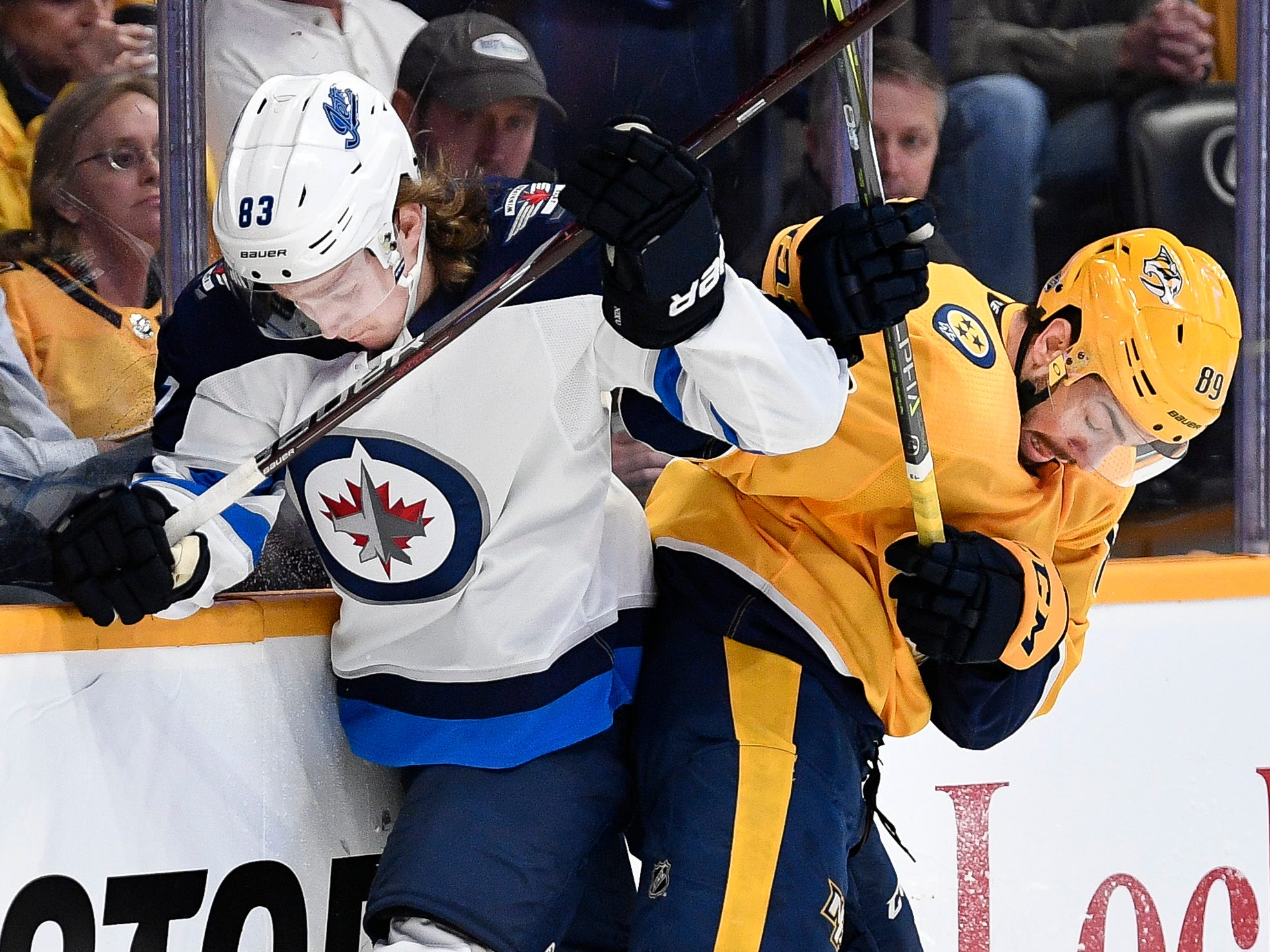Nashville Predators center Frederick Gaudreau (89) battles for the puck with Winnipeg Jets defenseman Sami Niku (83) during the first period at Bridgestone Arena in Nashville, Tenn., Thursday, Jan. 17, 2019.