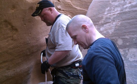 Wayne County search and rescue members approach David Cicotello in No Mans Canyon, Utah.