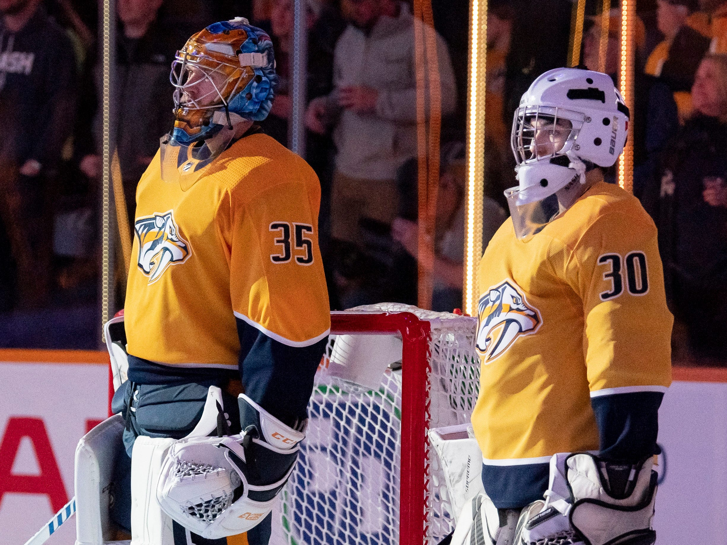 Make-A-Wish recipient Jacob Piros stands with Nashville Predators goaltender Pekka Rinne (35) before a game between the Nashville Predators and the Winnipeg Jets at Bridgestone Arena in Nashville, Tenn., Thursday, Jan. 17, 2019.