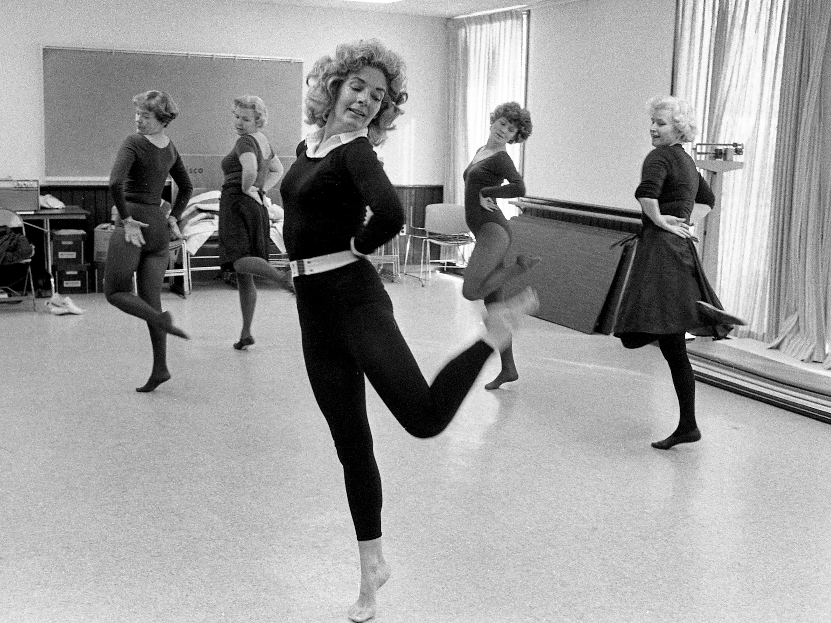"""Saturday Night Fever"" furnishes music for the""Disco Fit-Disco Trim"" class conducted by Dotty Mahanes, front, at the Southwest Family Branch of the YMCA on Jan. 3, 1979. In the class are Anne Wilson, left, Emily Parrish, Becky Bainbridge and Becky Clayton."
