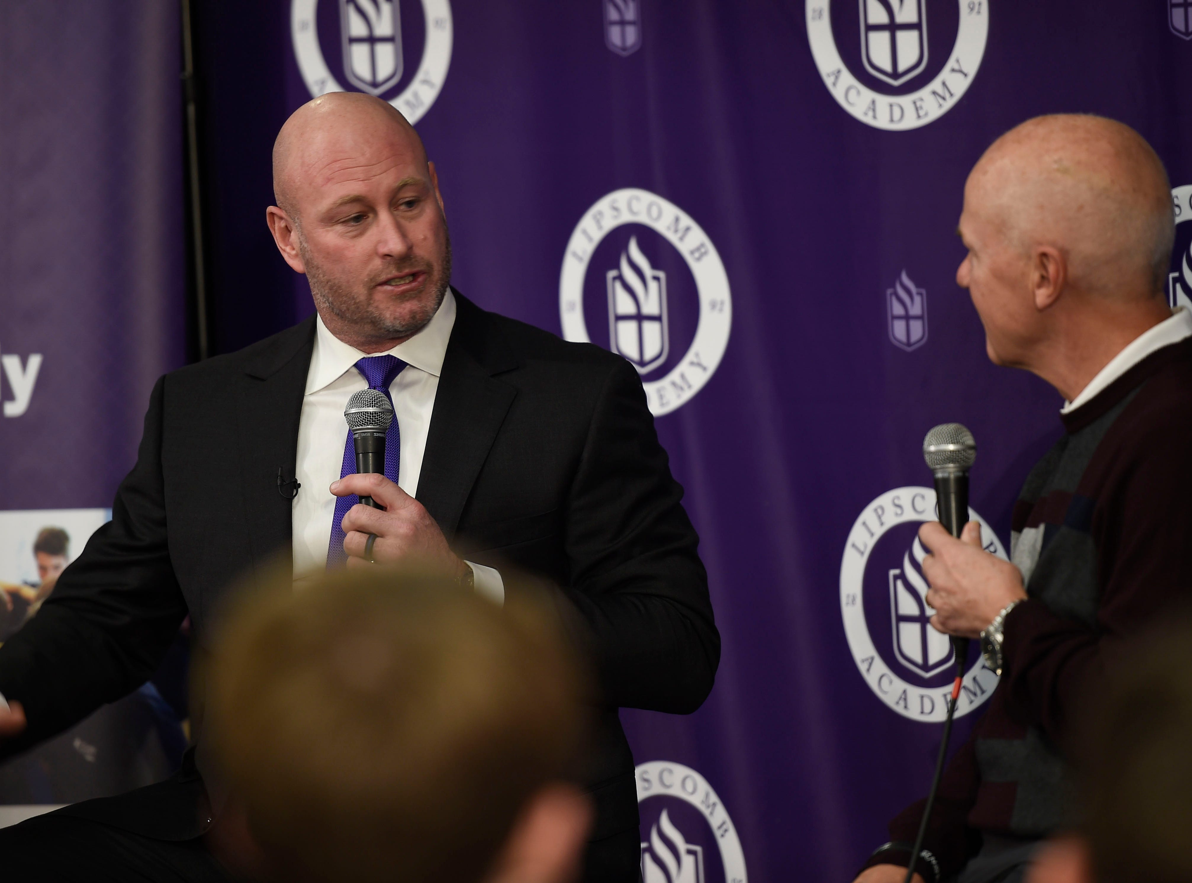 Trent Dilfer, the new football coach for Lipscomb Academy, speaks with Rudy Kalis following the press conference on Friday.