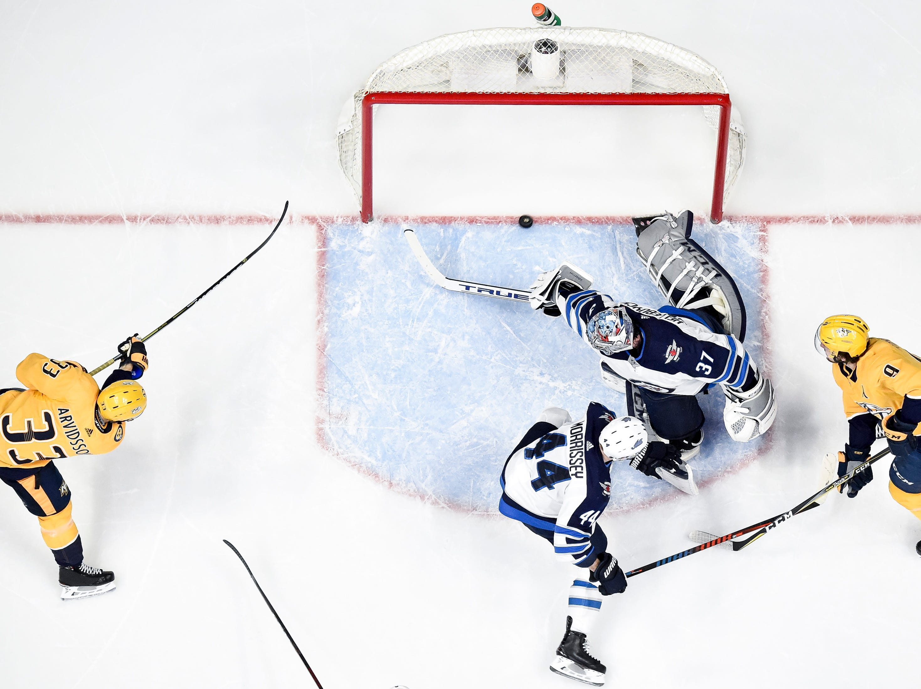 Nashville Predators right wing Viktor Arvidsson (33) scores past Winnipeg Jets goaltender Connor Hellebuyck (37) during the second period at Bridgestone Arena in Nashville, Tenn., Thursday, Jan. 17, 2019.