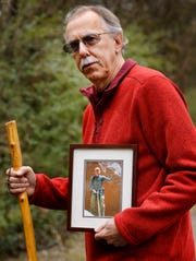 David Cicotello holds a photograph of his older brother, Louis Cicotello. Louis fell to his death in 2011 while the two brother were hiking in Utah. After the fall, David Cicotello survived six days stranded in a slot canyon before he was rescued.