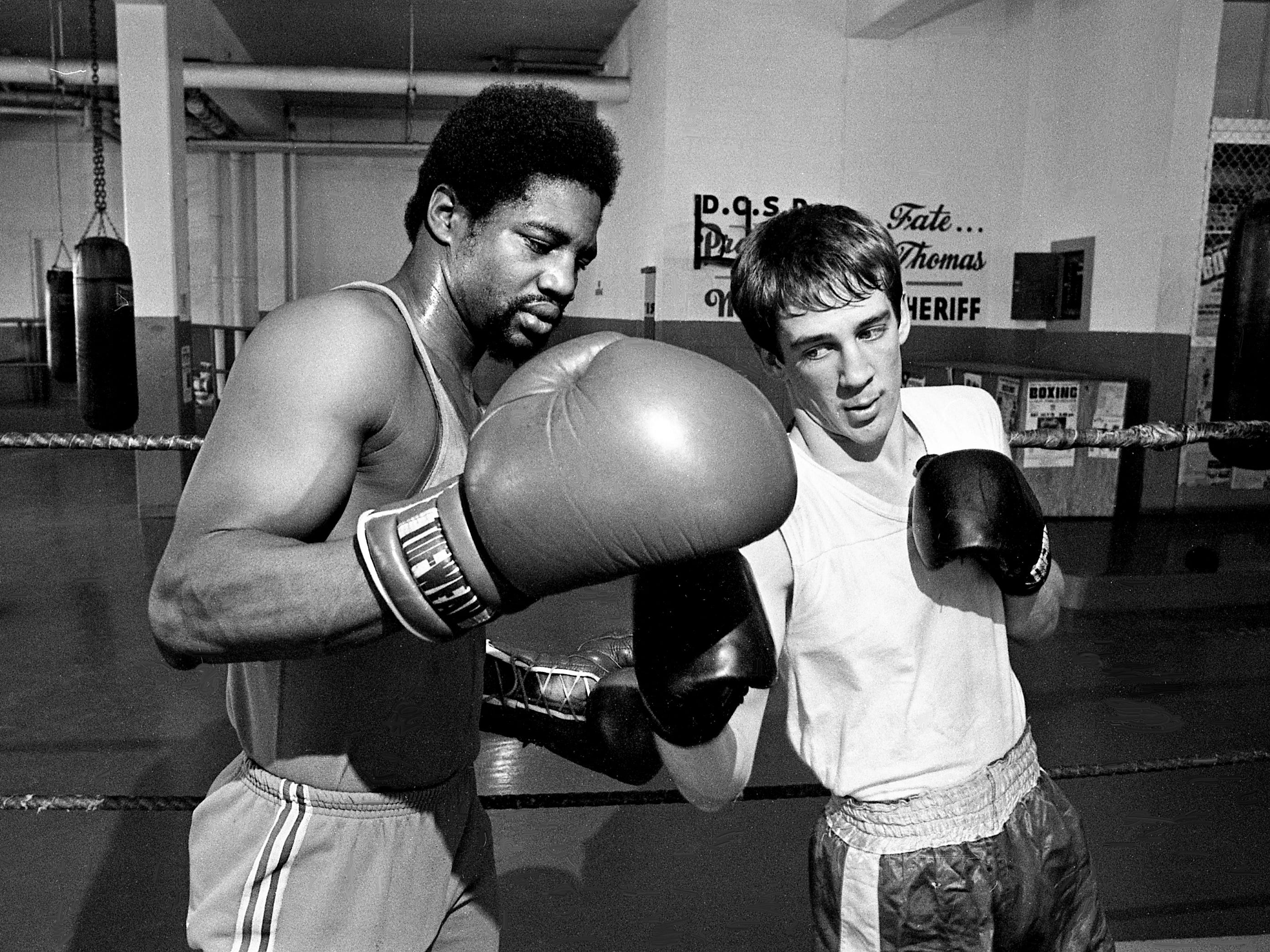 Clinton Jackson, left, gives pointers to one of his prized boxing students, Ray Loafman, during training at the Sheriff's Department Boxing Gym on Jan. 3, 1979. The pair will be in action Jan. 6 at the Fairgrounds Arena when the Sheriff's team hosts the U.S. Army boxers.