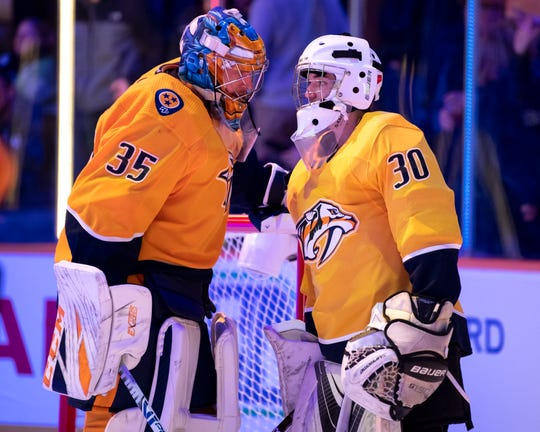 Make-A-Wish recipient Jacob Piros of Ionia chats with Nashville Predators goaltender Pekka Rinne (35) before a game between the Nashville Predators and the Winnipeg Jets at Bridgestone Arena in Nashville, Tenn., Thursday, Jan. 17, 2019.