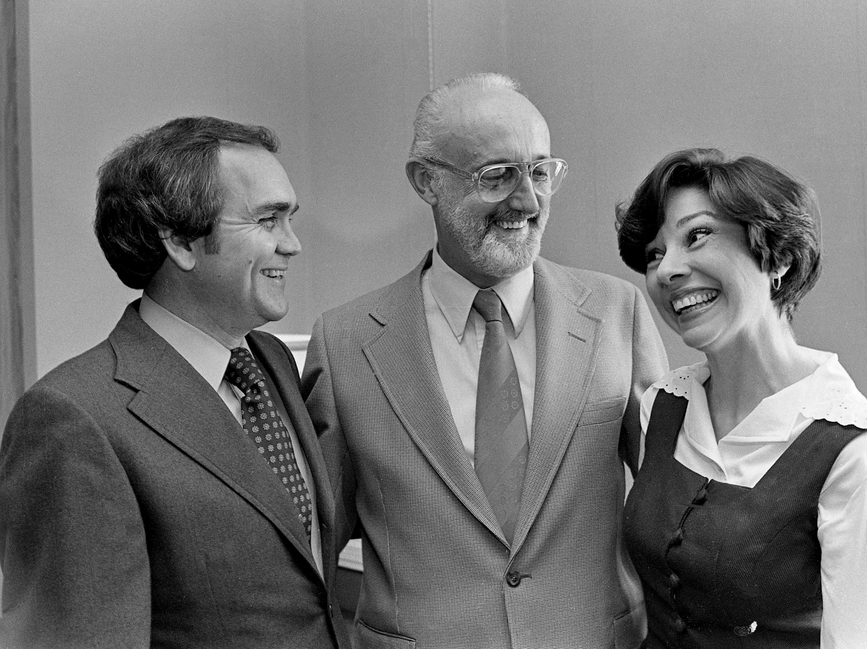 Reg Dunlap, left, president of Show Biz, Inc., producer of several nationally-syndicated television shows, discusses the company's new music publishing wing with Ed Penney, who will head their new autonomous company, and his assistant Pat Strawbridge on Jan. 24, 1979. Included in the new wing will be two BMI-affiliated companies, Show Biz Music and Song Biz, and two ASCAP-affiliated companies, Lucky Penny and Monster Music.