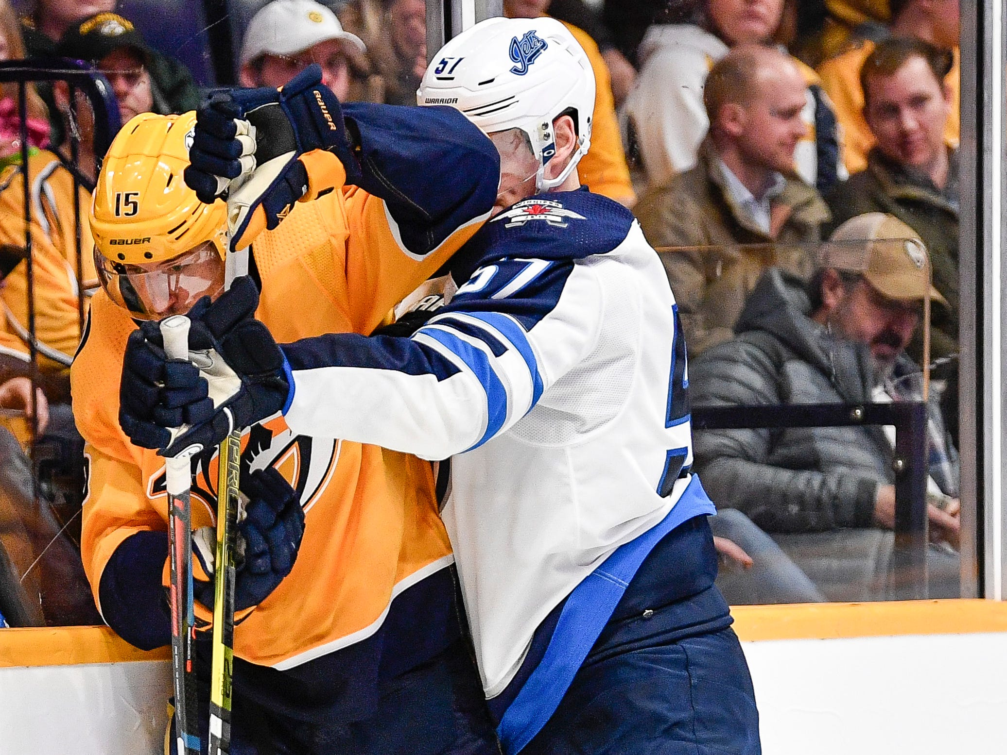 Nashville Predators right wing Craig Smith (15) battles Winnipeg Jets defenseman Tyler Myers (57) during the third period at Bridgestone Arena in Nashville, Tenn., Thursday, Jan. 17, 2019.