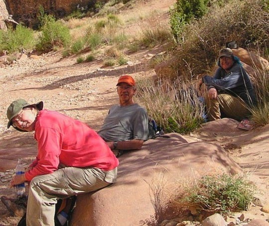 David Cicotello and his older brother Louis Cicotello, along with their friend Rex Welshon, in Chute Canyon in the San Rafael Swell, Utah.