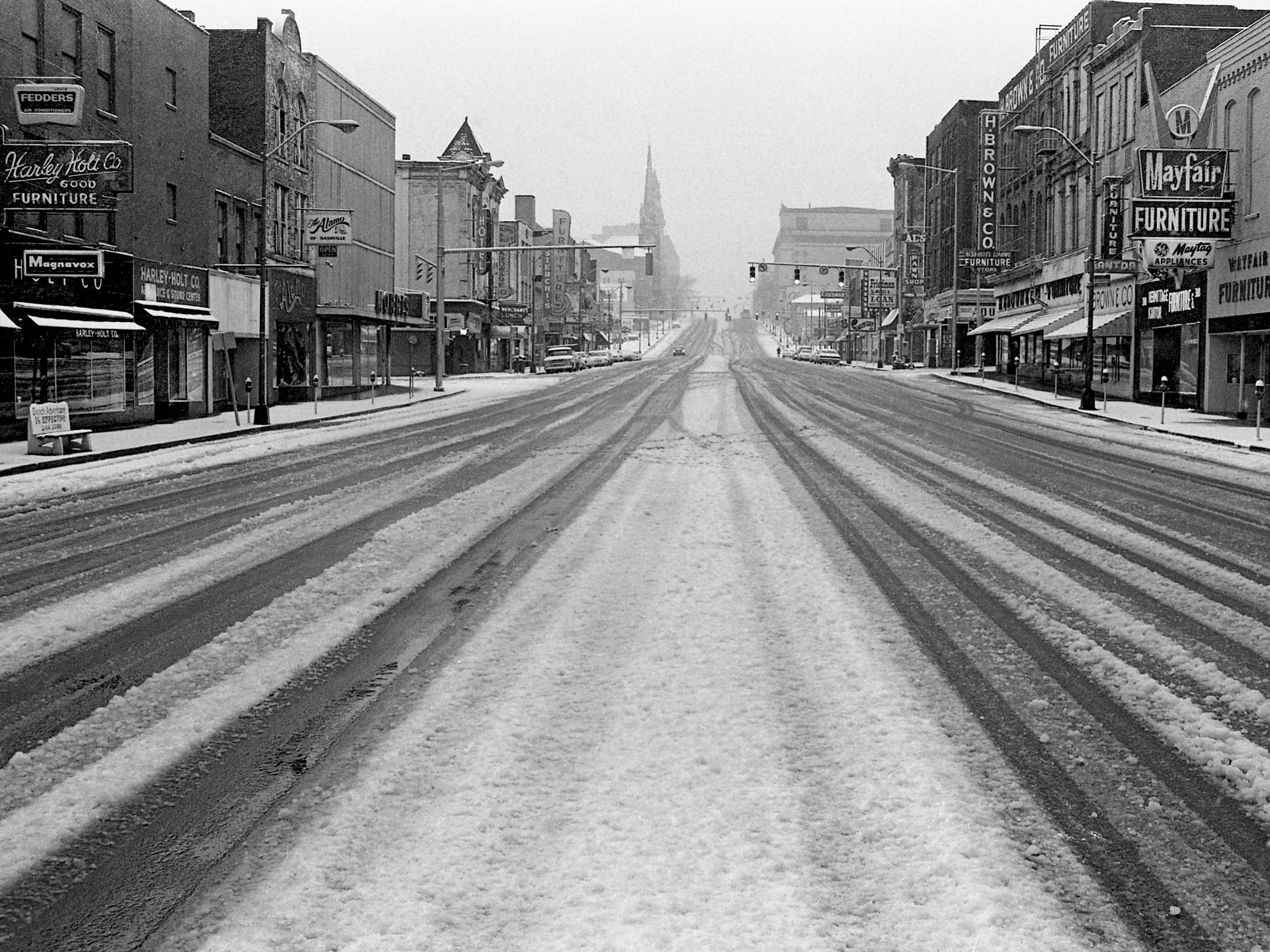 Most motorists seem to be avoiding driving on the snow-covered Lower Broadway Jan. 21, 1979.