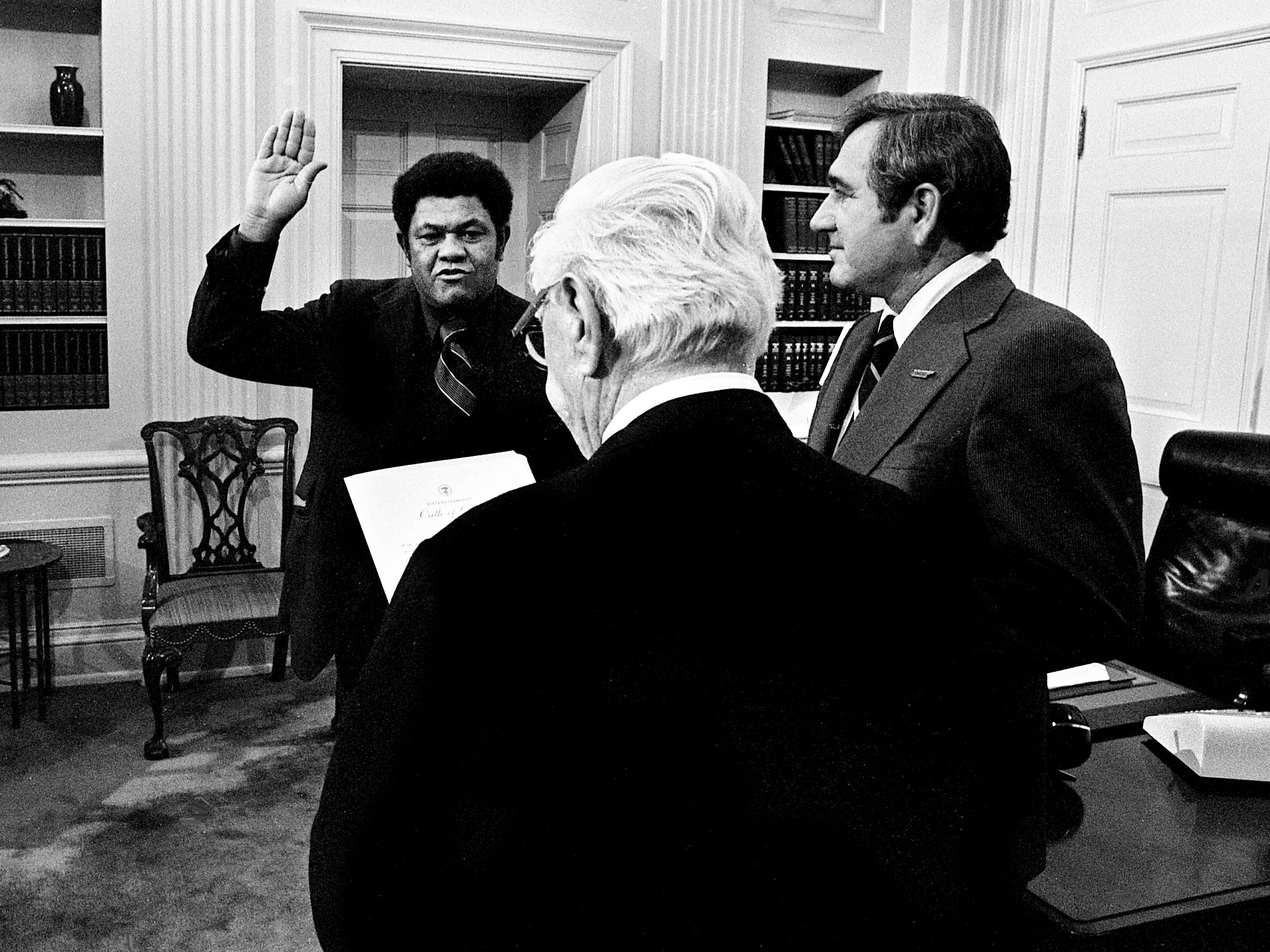 Otis Floyd, left, former state deputy education commissioner, is being sworn in as education commissioner by State Court of Appeals Judge Thomas Shriver with Gov. Ray Blanton looking on in his office at the State Capitol on Jan. 3, 1979. Floyd replaces Sam Ingram, who became president of Middle Tennessee State University. Floyd will serve until Blanton leaves office Jan. 20.