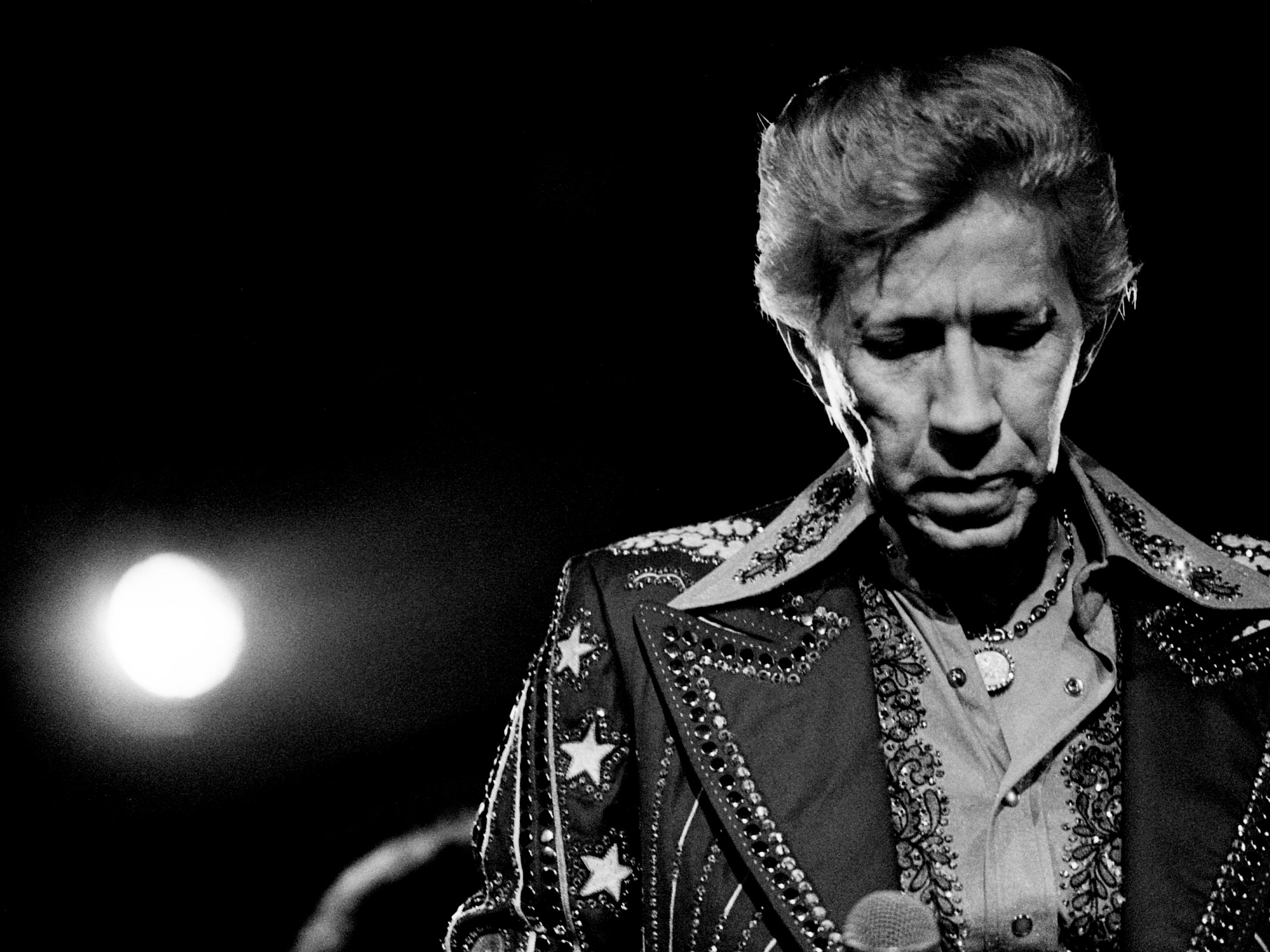 Porter Wagoner finishes up one of his traditional songs before a standing-room only crowd at the Exit/In Jan. 31, 1979. Wagoner was unquestionably a hit, but his much-anticipated disco debut was a lot closer to the Grand Ole Opry than Studio 54.