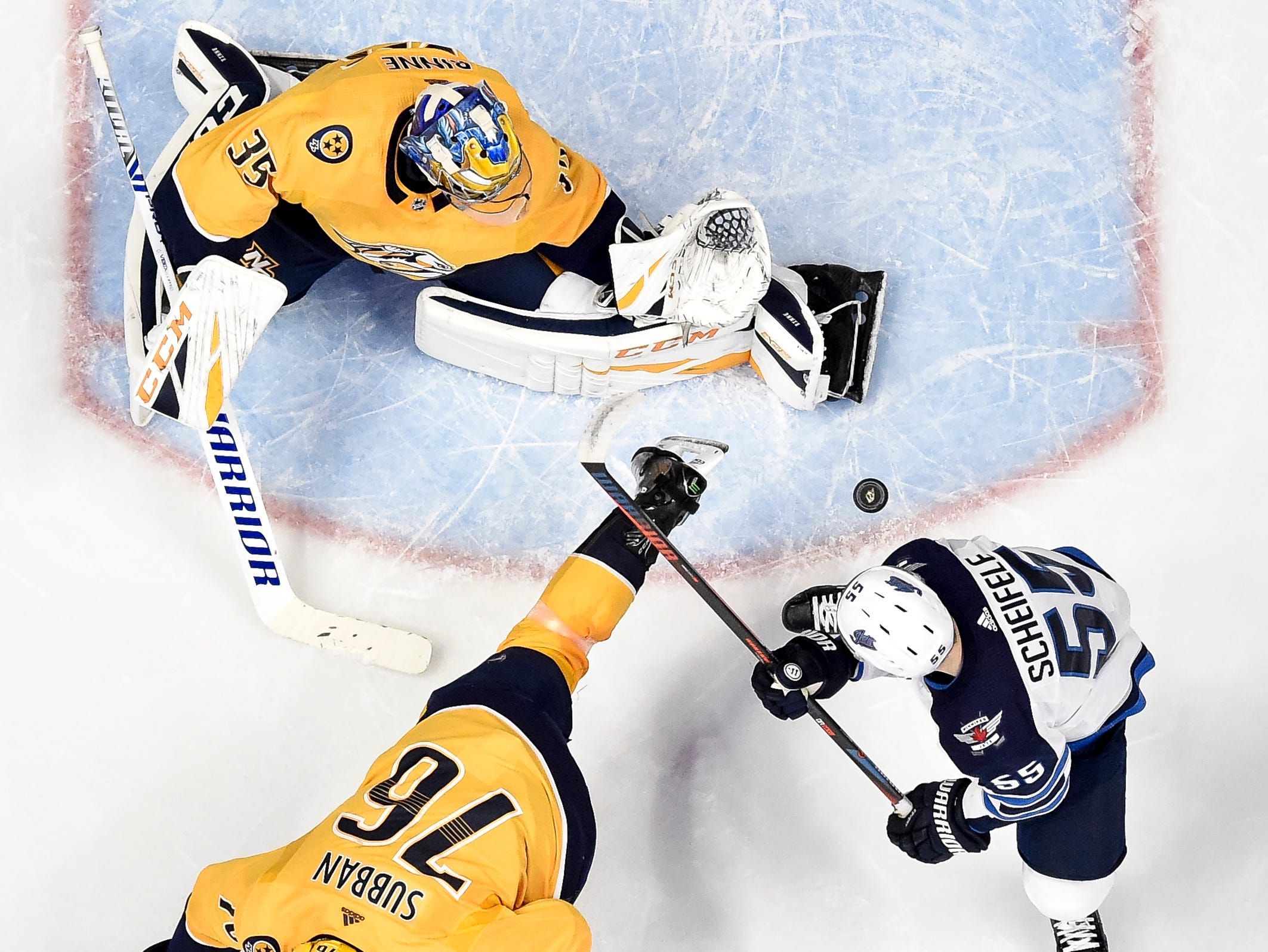 Nashville Predators goaltender Pekka Rinne (35) and defenseman P.K. Subban (76) defend against Winnipeg Jets center Mark Scheifele (55) during the first period at Bridgestone Arena in Nashville, Tenn., Thursday, Jan. 17, 2019.