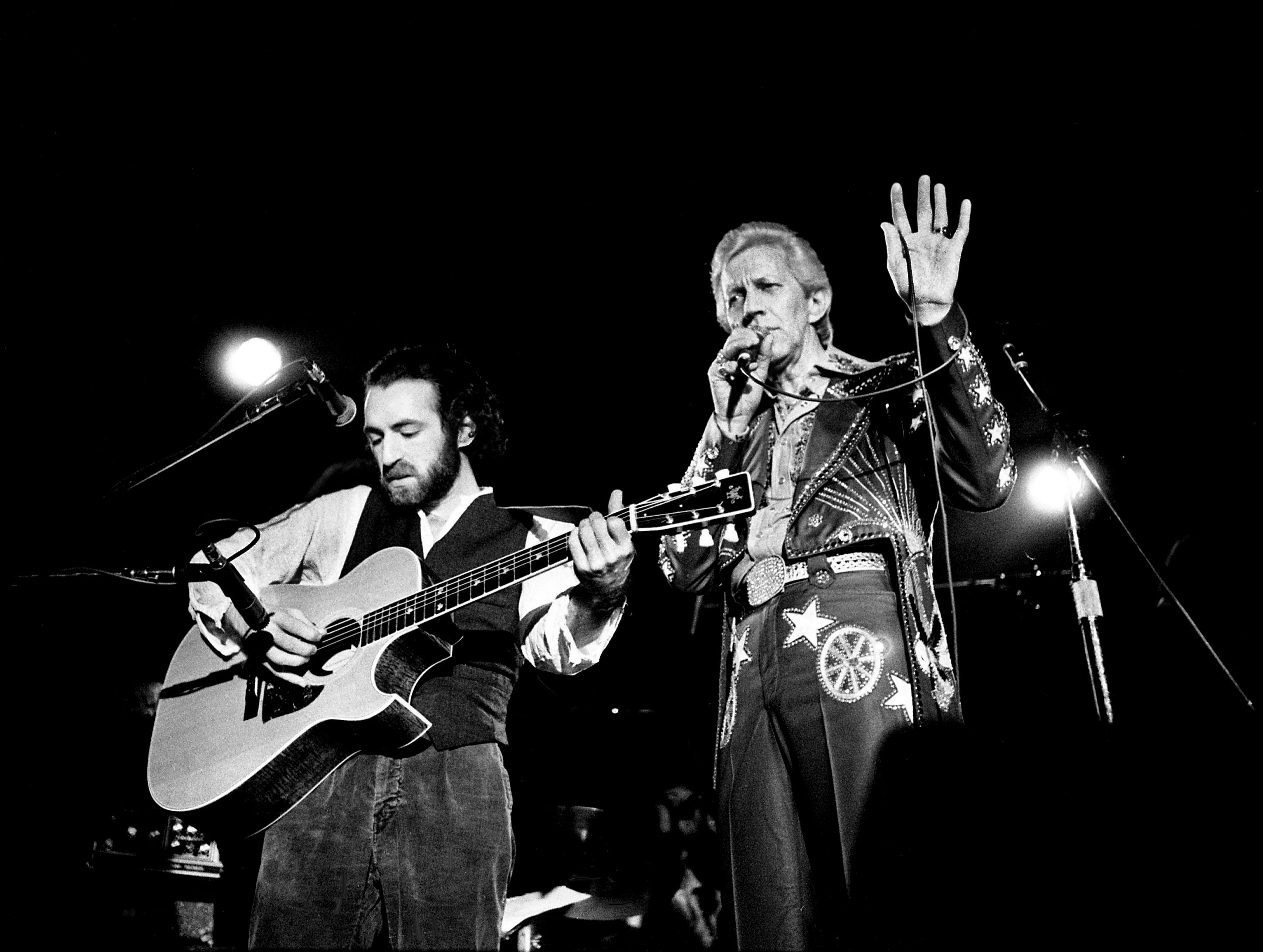 Porter Wagoner, right, is introducing one of his guest performers, Jay Bolotin, during his show at the Exit/In Jan. 31, 1979.