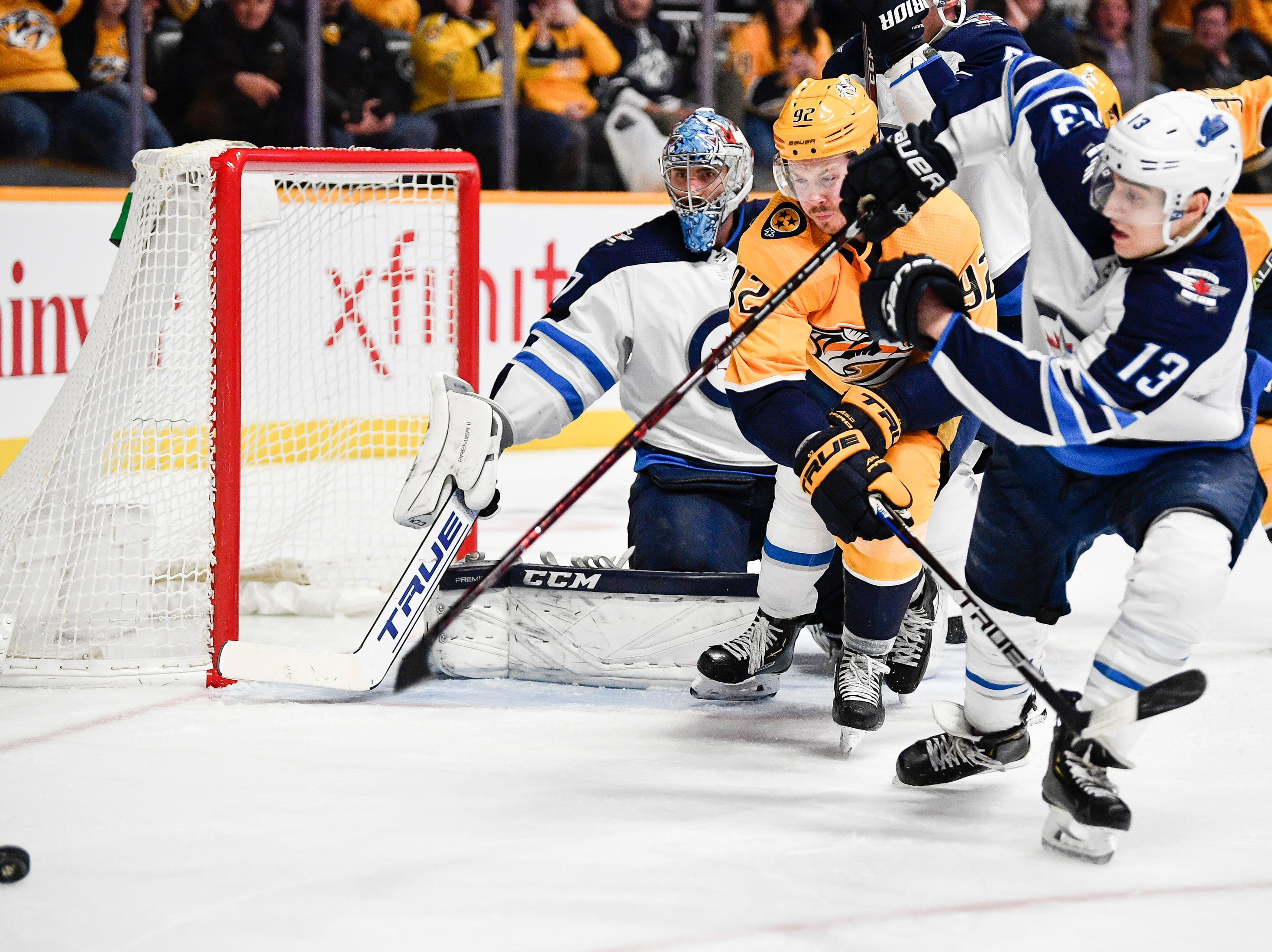 Nashville Predators center Ryan Johansen (92) fights for the puck with Winnipeg Jets left wing Brandon Tanev (13) during the third period at Bridgestone Arena in Nashville, Tenn., Thursday, Jan. 17, 2019.