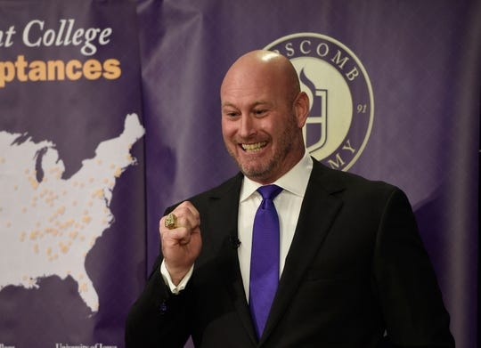 Trent Dilfer, the new football coach for Lipscomb Academy, shows off his Super Bowl ring to the crowd after joking that he's never lost a game in Tennessee.