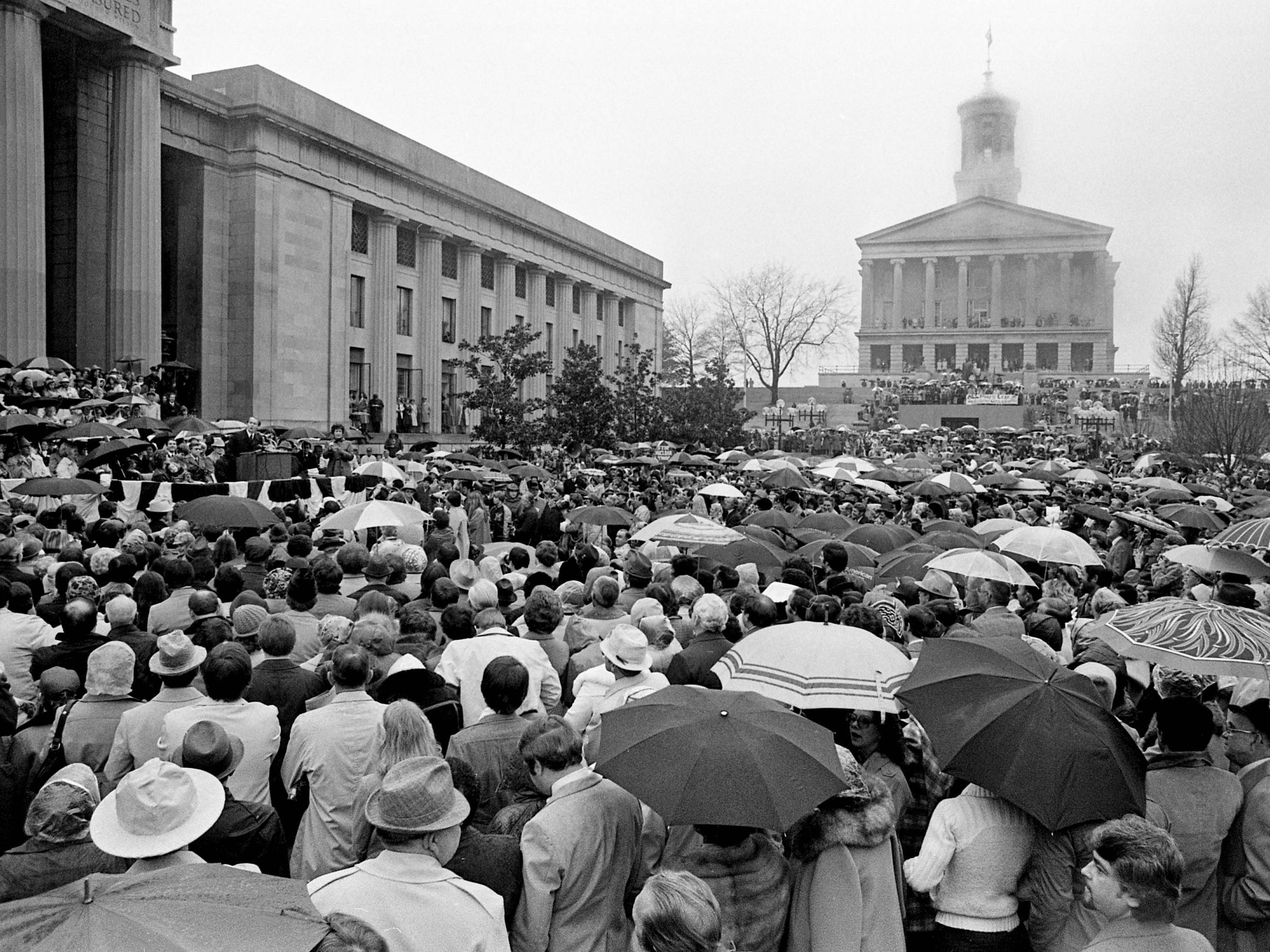 Gov. Lamar Alexander delivers his inaugural speech to a crowd that overflows the Legislative Plaza despite dreary weather Jan. 20, 1979.
