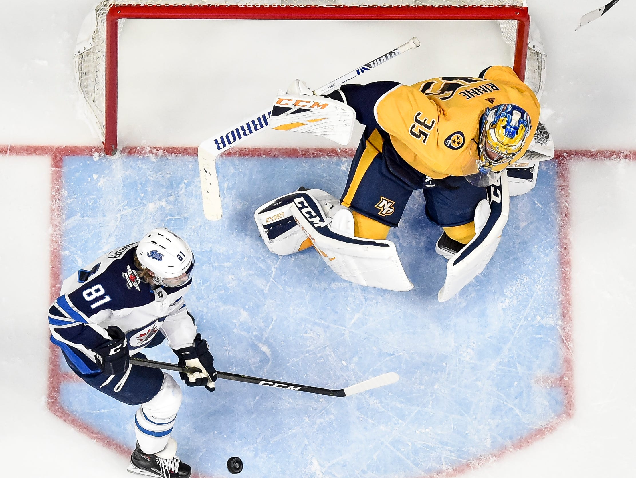 Nashville Predators goaltender Pekka Rinne (35) defends against Winnipeg Jets left wing Kyle Connor (81) during the third period at Bridgestone Arena in Nashville, Tenn., Thursday, Jan. 17, 2019.