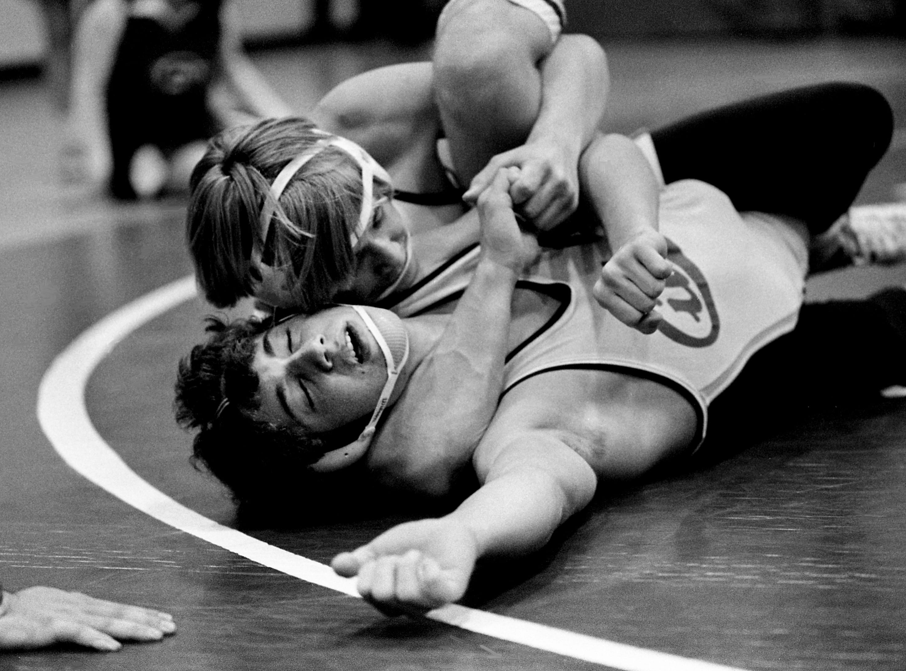 Terry Canady, top, of Hillwood High has the upper hand, not to mention a tight grip, on Todd Corn of Cheatham County High during first round action of the 145-pound division of the Bellevue Invitational wrestling tournament Jan. 19, 1979. Canady went on to a 20-3 victory to move on to the next round.