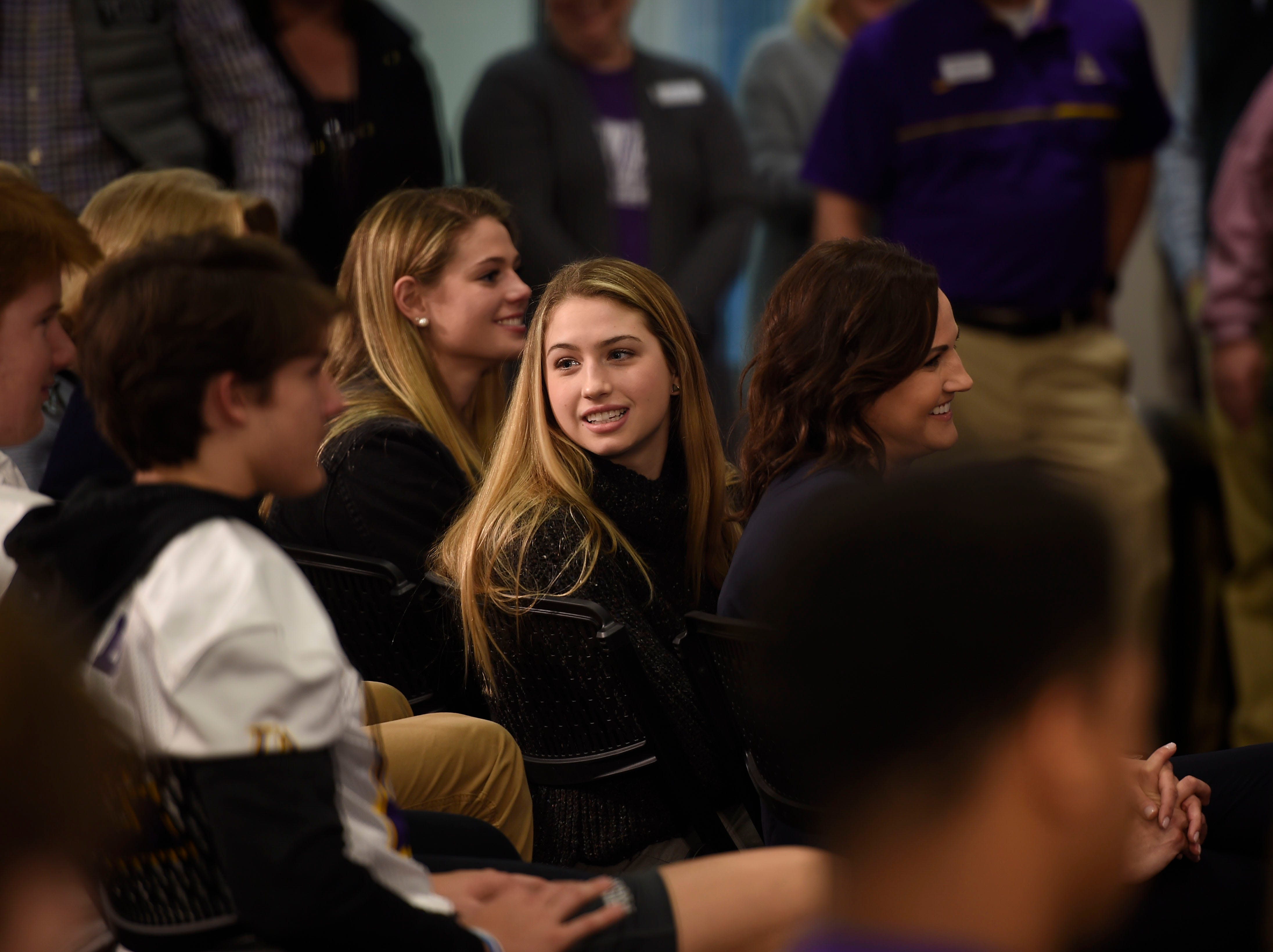 Trent Dilfer's daughters and wife laugh at a joke made by Dilfer during his press conference announcing him as the new Lipscomb Academy football coach.