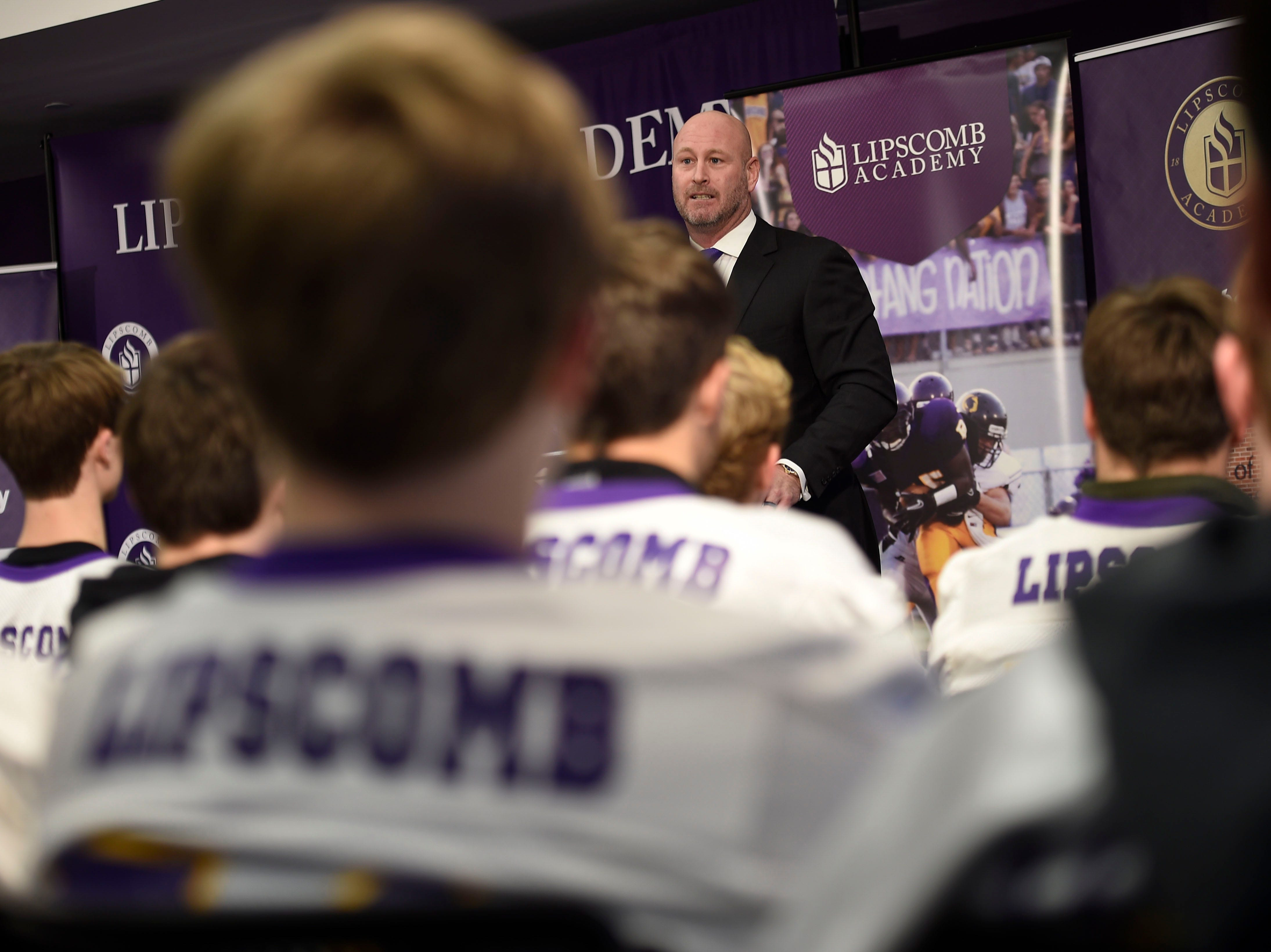 Trent Dilfer, the new football coach for Lipscomb Academy, addresses a packed room following the announcement on Friday.