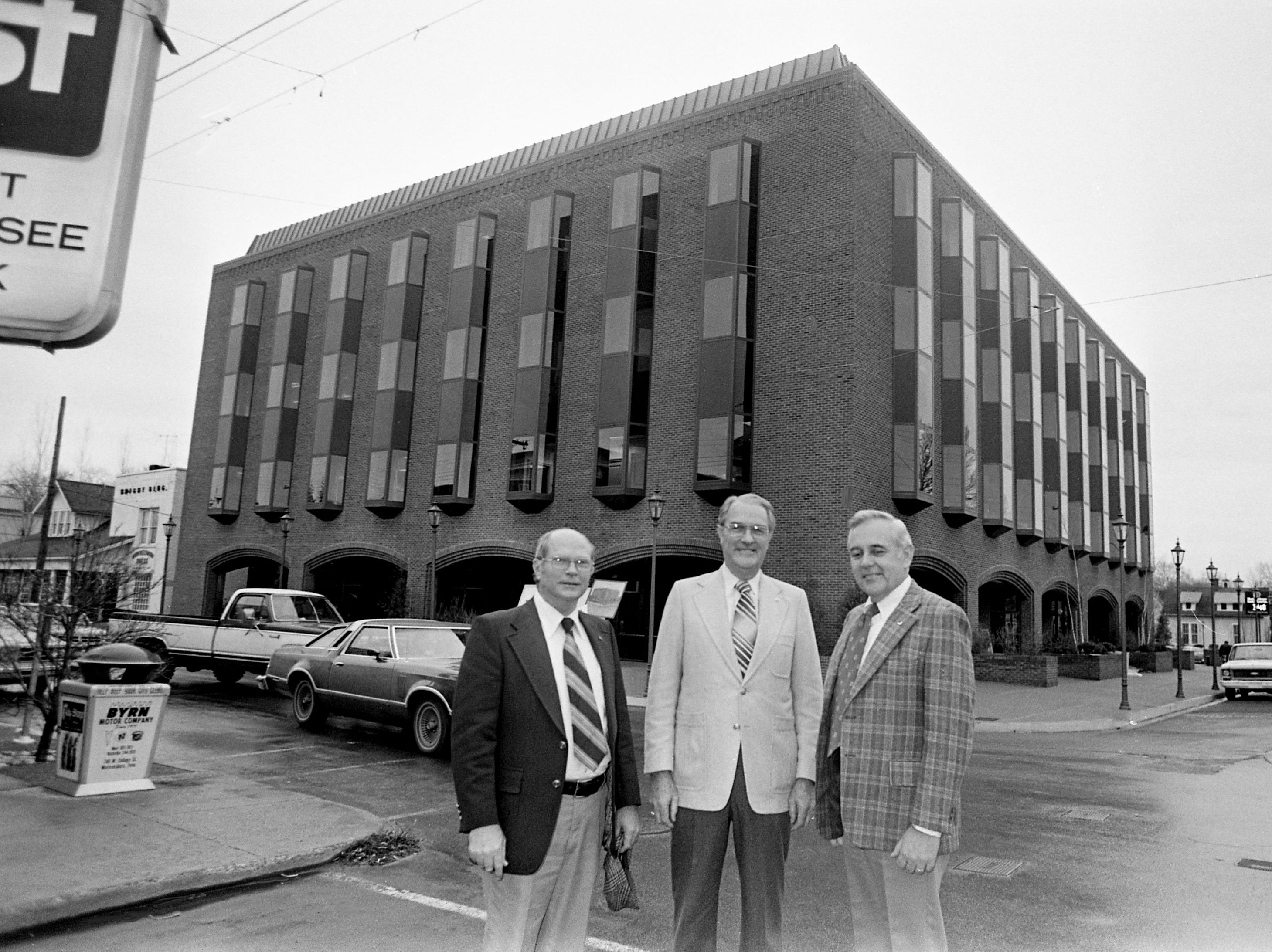 Murfreesboro Bank and Trust Co. officials Jack Holden, left, executive vice president; Ed Loughry, president; and Jack Weatherford, board chairman, stand by the new main office in downtown Murfreesboro on Jan. 19, 1979, that is ready for the move in.