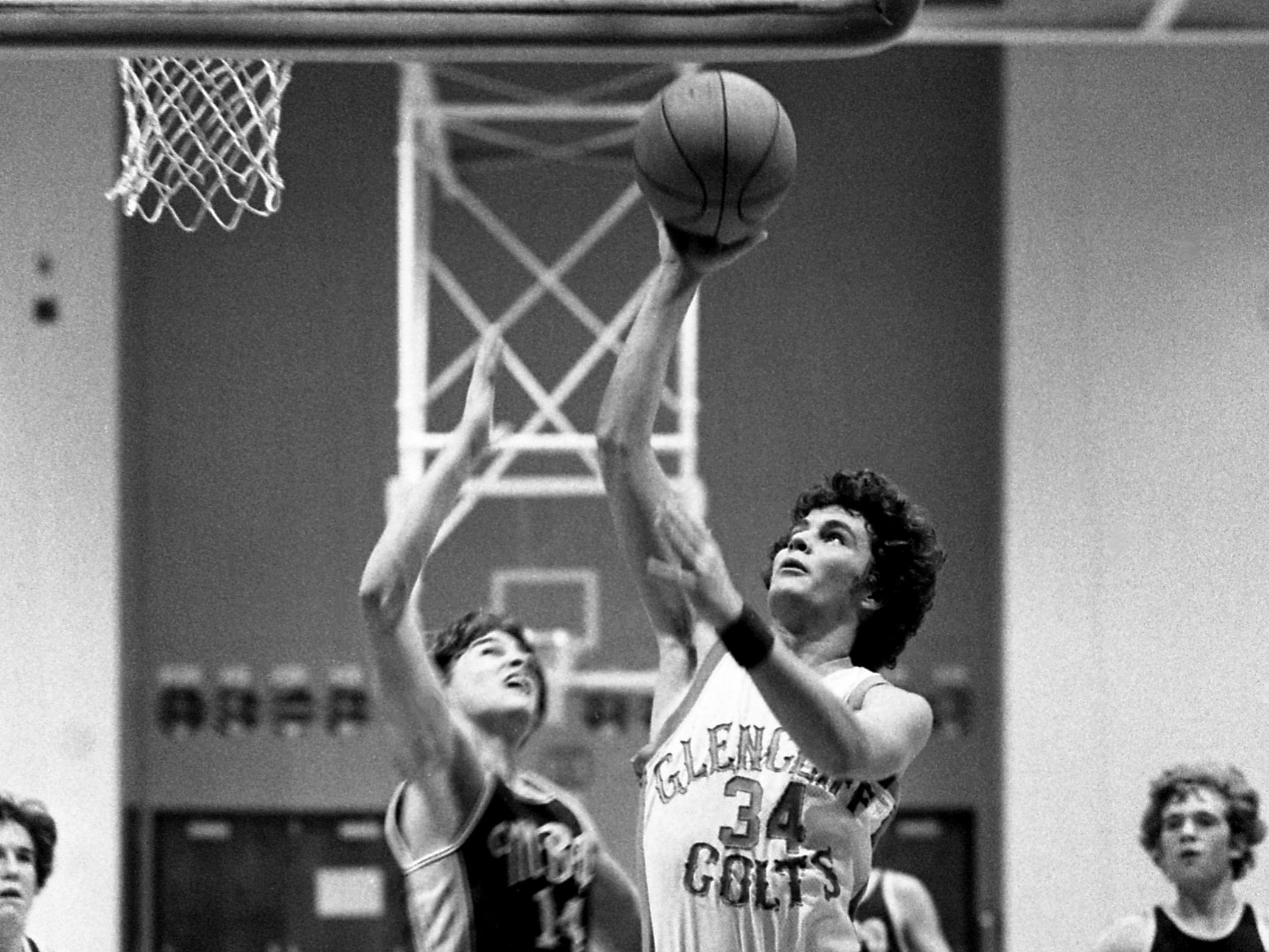 Glencliff High's Jeff Walker (34) moves in for two of his eight points against Montgomery Bell Academy's Bob Calton (14) during their heated NIL battle Jan. 19, 1979. But the underdog MBA went on the road to upset Glencliff 55-53 in District 11-AAA battle.