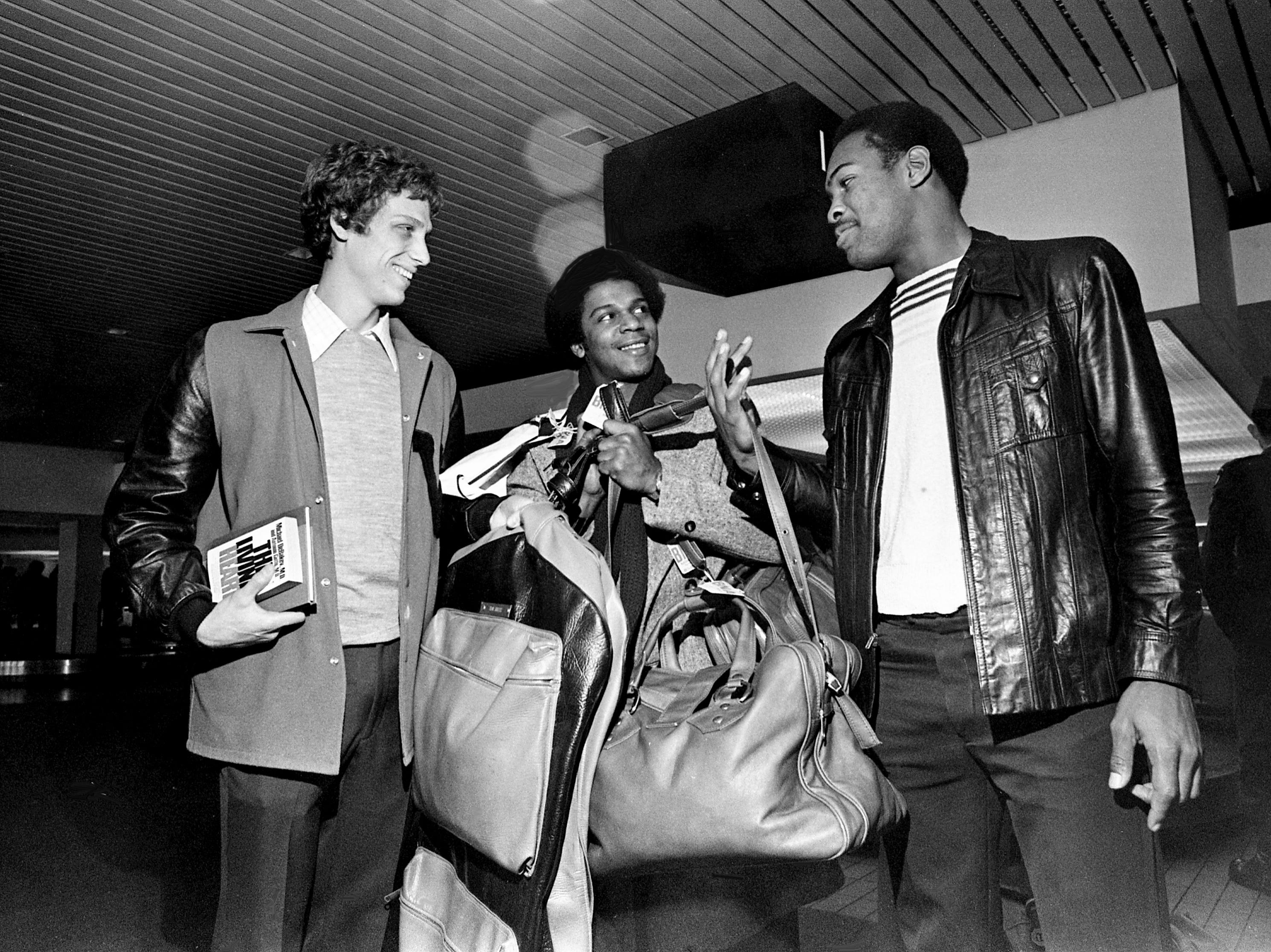 Vanderbilt's basketball team was understandably happy to be back home with their first SEC win after a visit to Auburn. Rounding up luggage at Nashville Municipal Airport on Jan. 4, 1979, are the Commodores stars of their conference opener win, Tom Shultz, left, Tommy Springer and Greg Fuller.