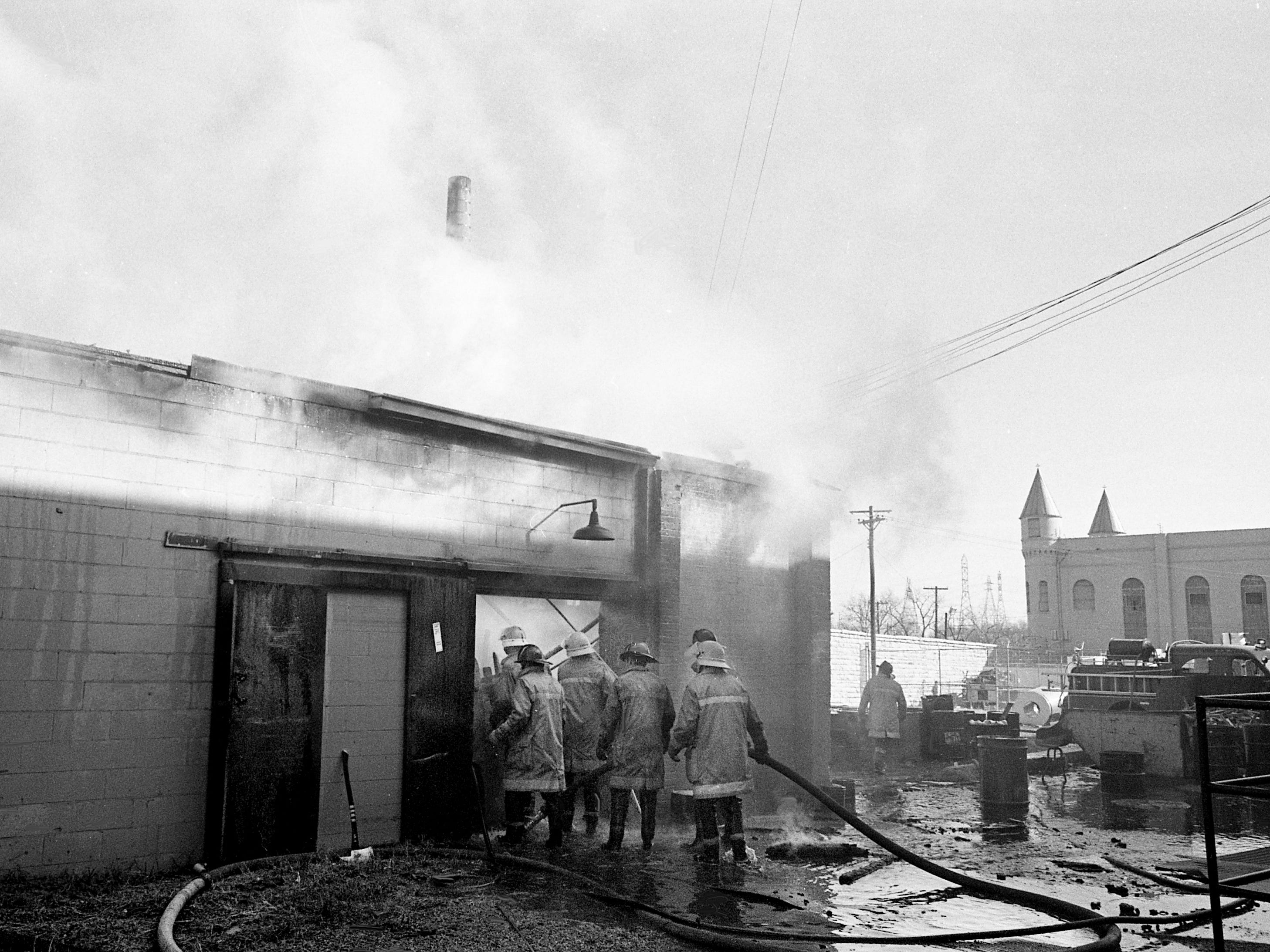 Metro firefighters battle a two-alarm blaze, which gutted the welding shop at the Tennessee State Prison on Jan. 4, 1979. Although no injuries were reported, officials estimated damages from the fire may total $100,000.