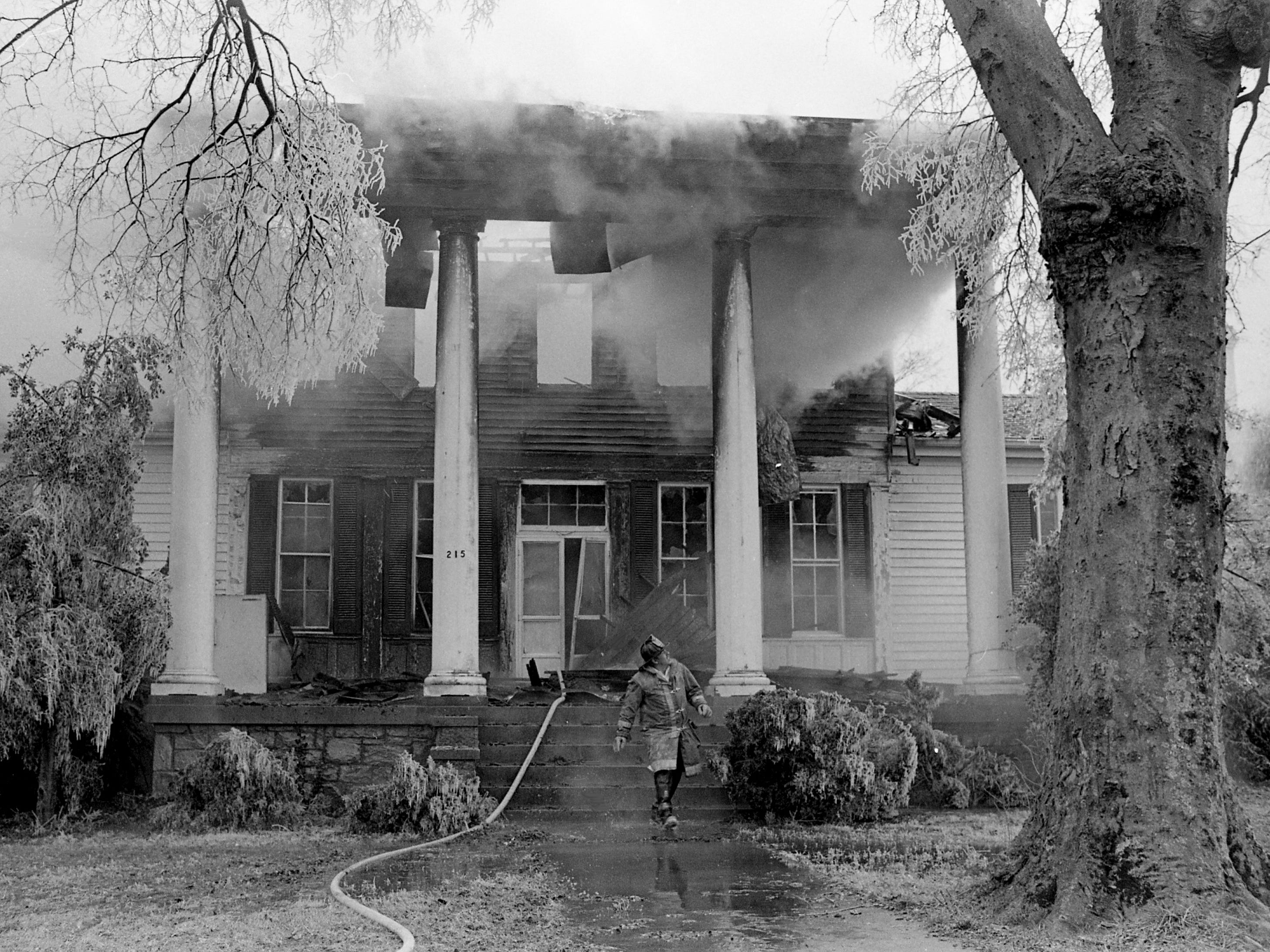 Firefighters are putting out a blaze that heavily damaged the upper floors of a vacant house at 215 Blanton Ave. on Jan. 2, 1979. The house owners, Mr. and Mrs. George T. Sain, said the 36-room house had been vacant for nine years and was supervised by a caretaker who was absent when the fire broke out.