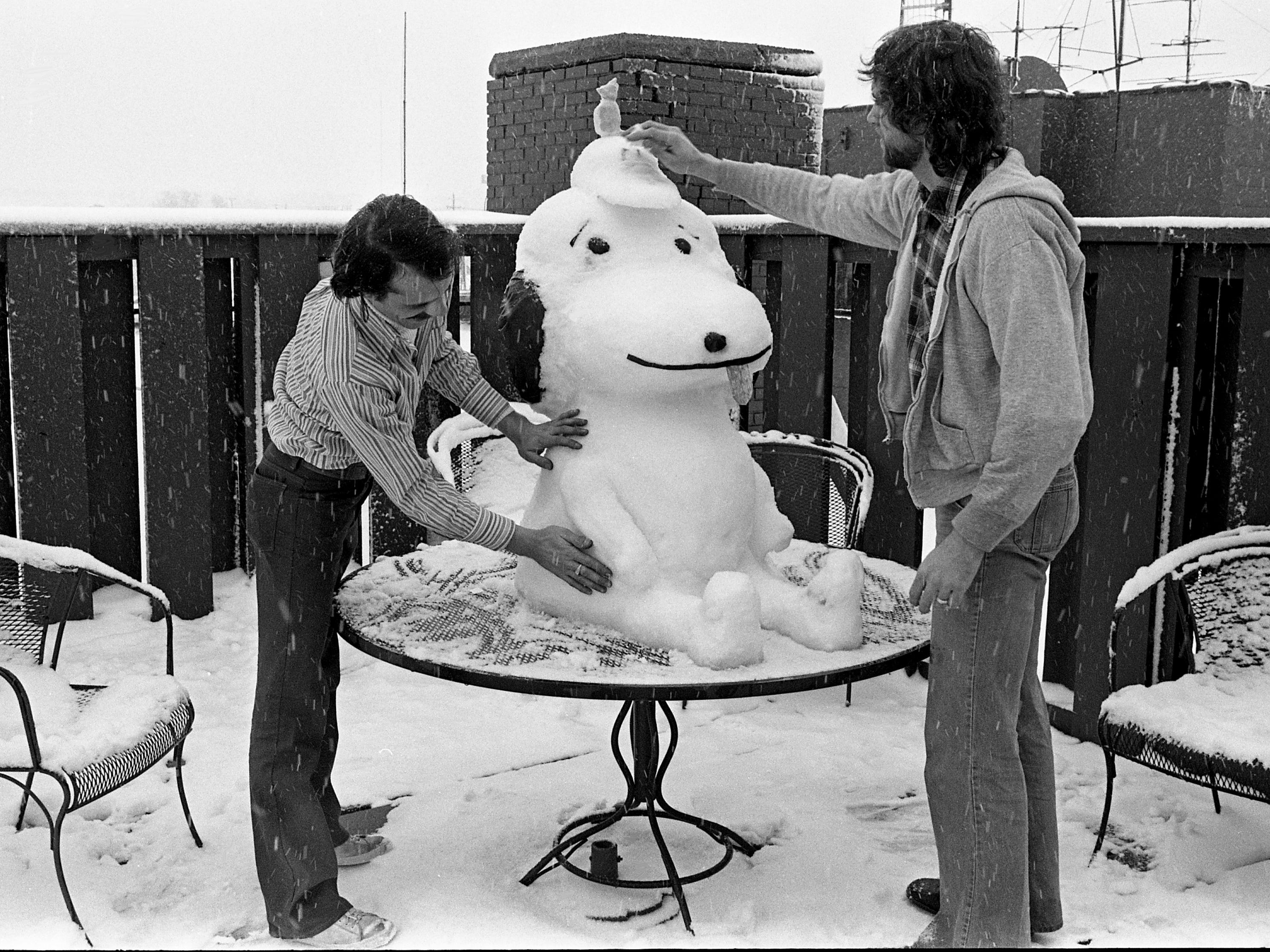 Good grief, Charlie Brown! Your well-known canine friend has been immortalized in, well, in snow on Jan. 21, 1979. The sculptors at work on this masterpiece of icy art are Roger Berry and Gary Kelley.