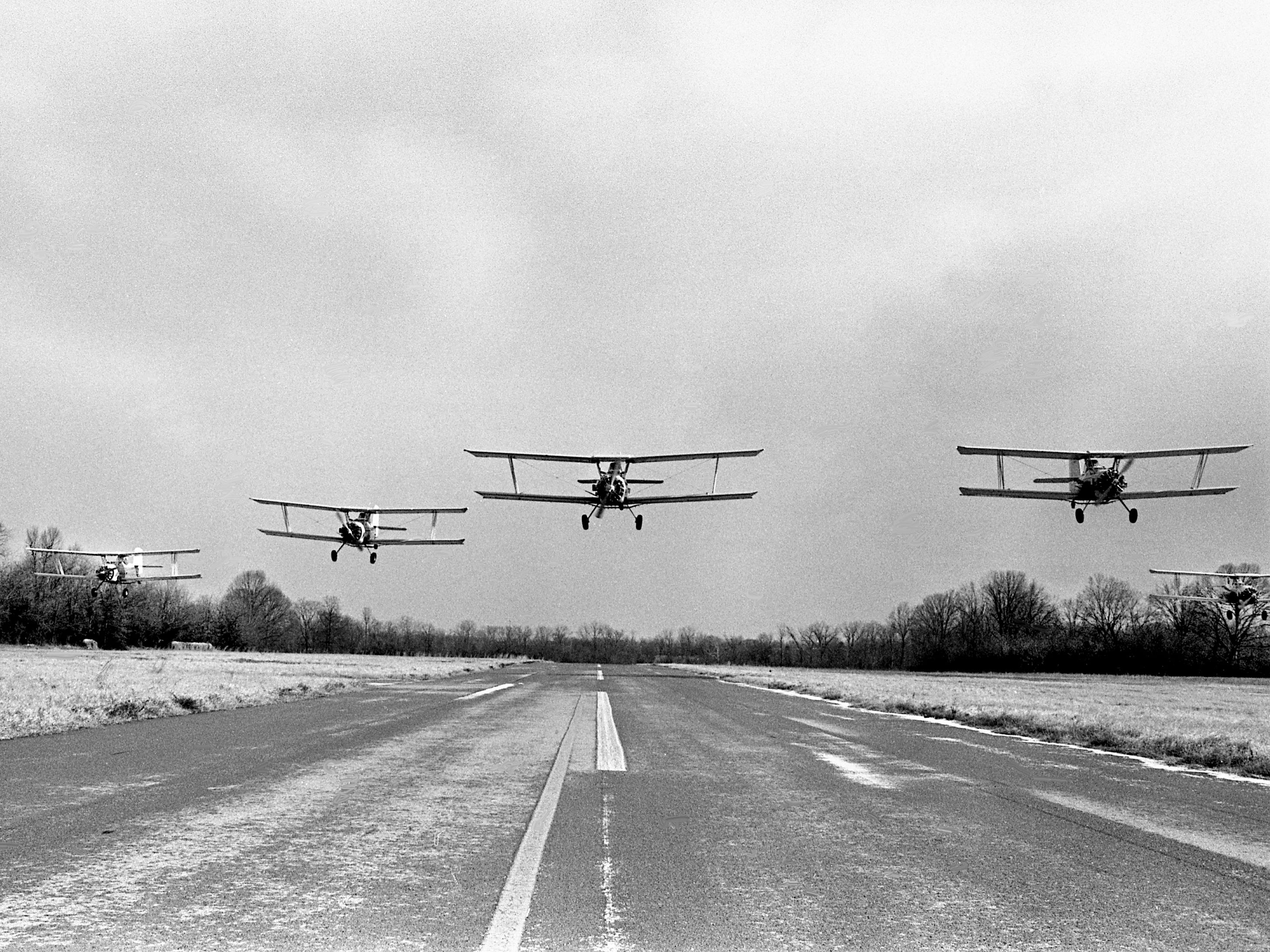 A pre-dawn raid to seek out the Red Baron? Not quite, these similar to vintage World War I aircrafts are really new Grumman Ag-Cats being ferried from the factory in New York to Missouri. The mainly crop-dusting planes are leaving Cornelia Fort Airpark on Jan. 31, 1979, for the final leg of their trip after spending the night.