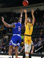 Tennessee Tech's Corey Tillery shoots over Tennessee State's Dave Morris in Thursday's game at Eblen Center.