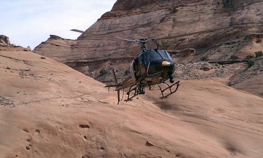A Wayne County, Utah, search and rescue helicopter prepares to rescue David Cicotello in No Mans Canyon.