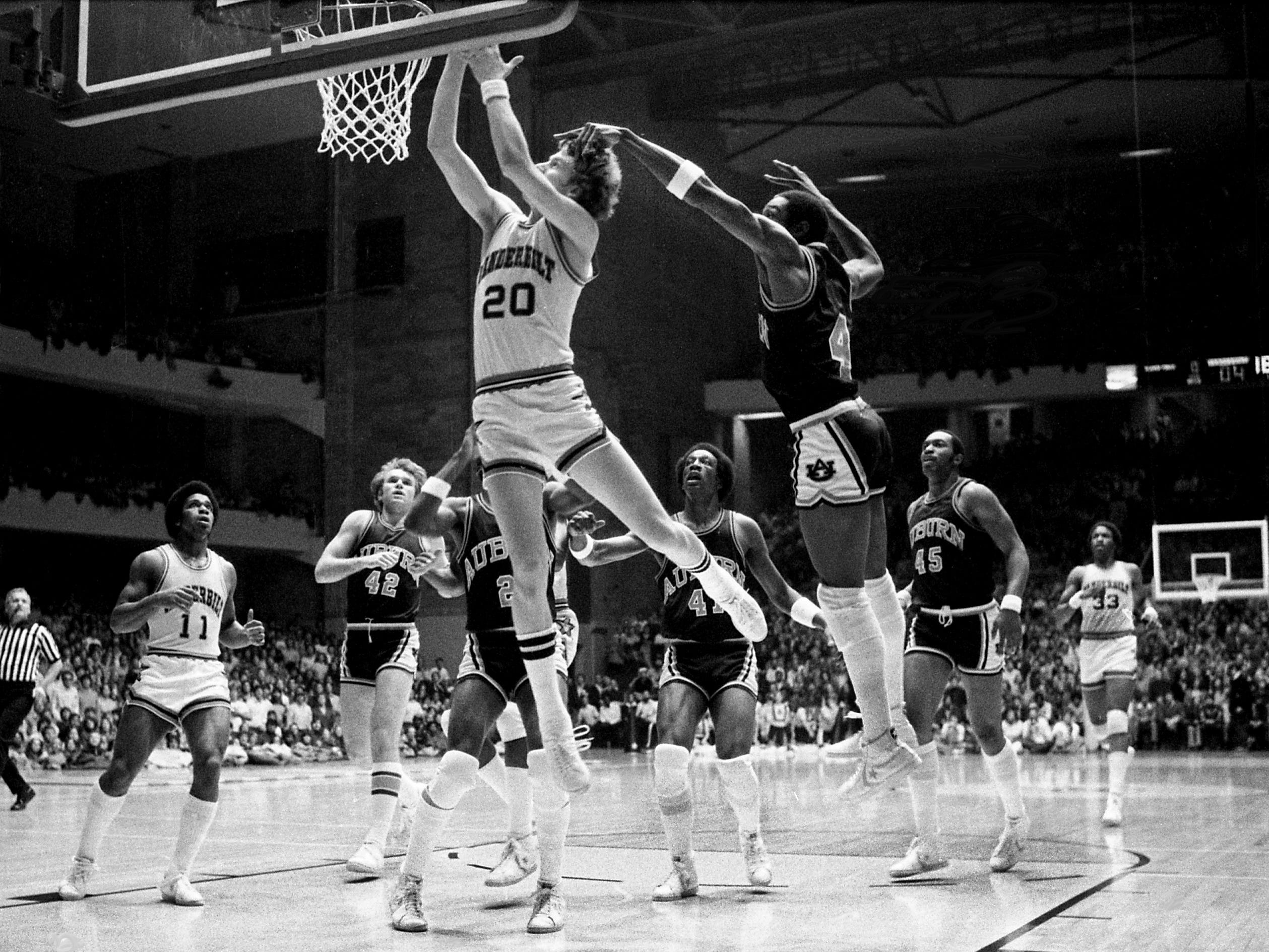 Vanderbilt sophomore forward Mike Rhodes (20) attempts a layup as Auburn's close-guarding Lewis Card takes a swipe at Memorial Gym Jan. 27, 1979. Rhodes ended up with 14 points in helping the Commodores to a 66-59 victory over Auburn in a major SEC battle.