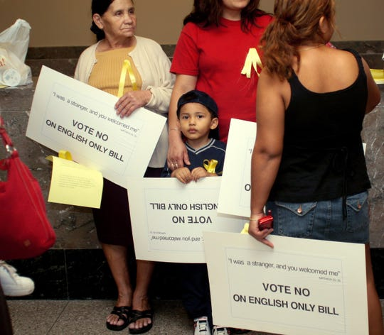 -  -Text: Mike Alvarado, 3, stands with his family including his grandmother Angela Portillo, 63, (left) in the Metro Court Building before the council meeting of the propsed English-Only Bill.(September 19, 2006)LaVondia Majors/The Tennessean