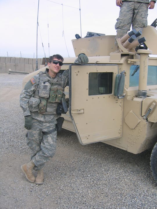 Jay Strobino stands next to his truck just after a mounted patrol in Mahmudiyah, Iraq.