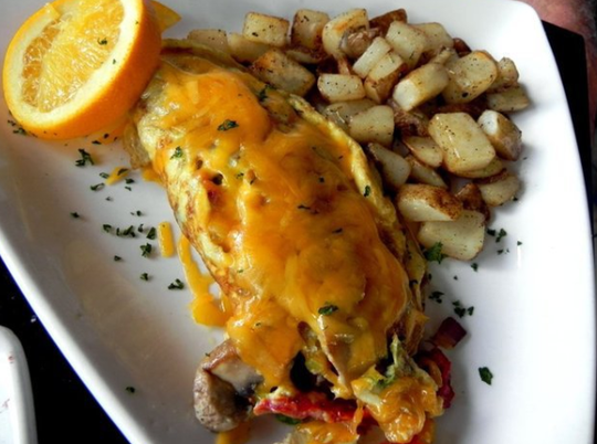 "This archive photo from 2015 shows a ""fusion"" omelet prepared with the choice of four ingredients — a top brunch choice served with tasty breakfast potatoes at The Wine Loft in Mercato."