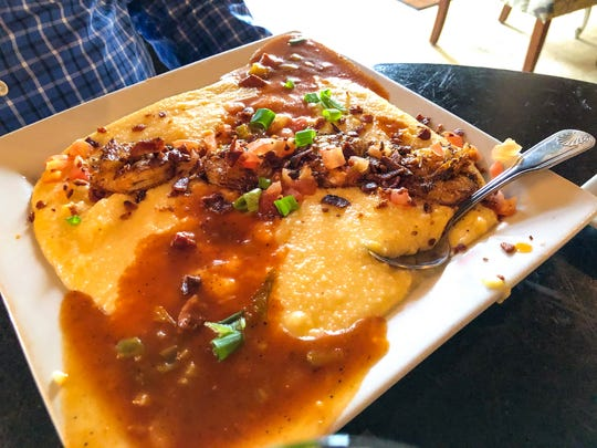 Shrimp and Grits, Blackened gulf shrimp, pork belly bacon bits, cheddar grits, tomatoes, tasso ham jus for $12.95 at Fancy's Southern Cafe in Fort Myers.The picture was shot for National Southern Food Day that is celebrated all around the United States on January 22nd each year.